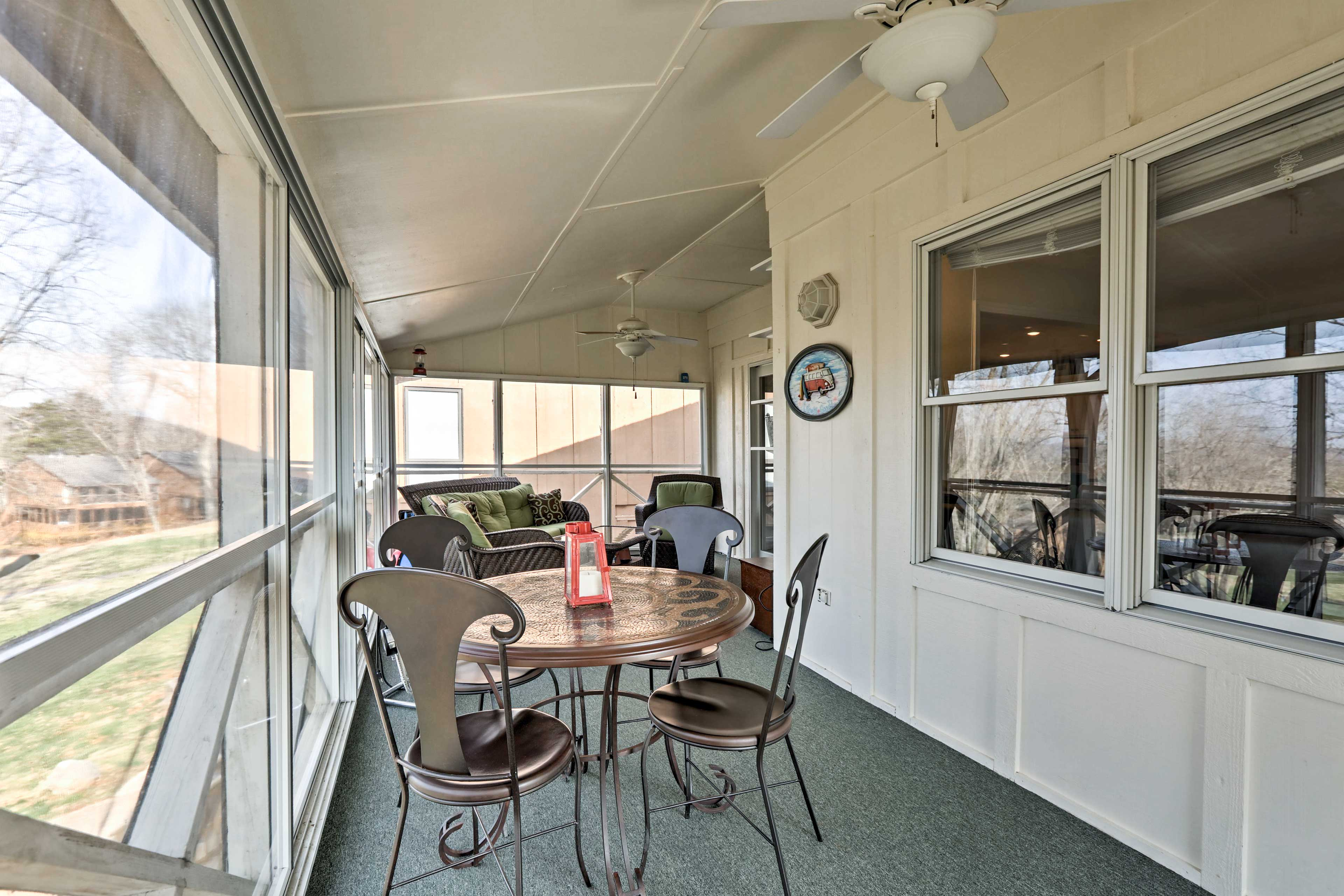 Eat dinner on the enclosed wraparound porch while basking in a lakeside sunset.
