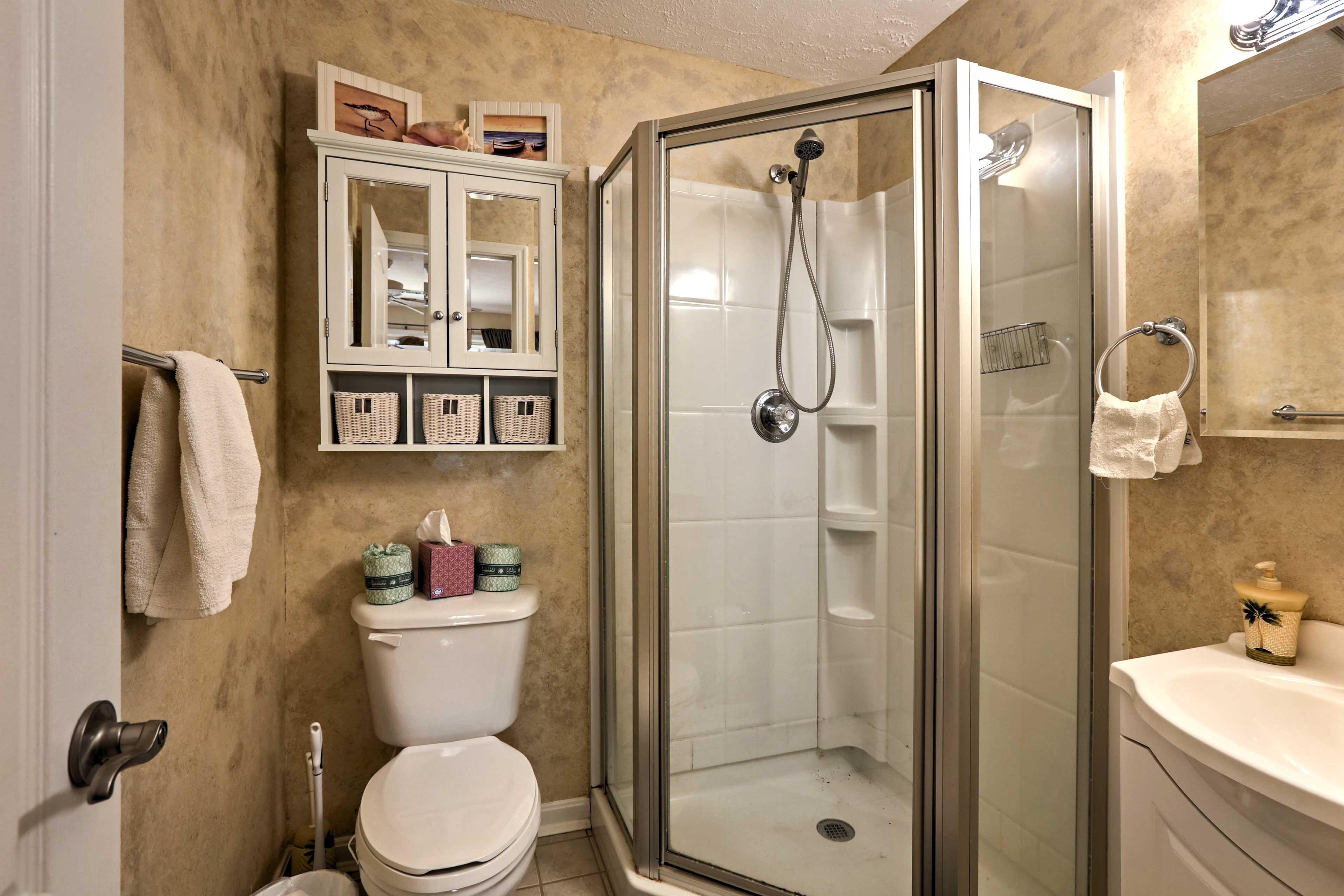 An en-suite bathroom with walk-in shower accompanies the master bedroom.