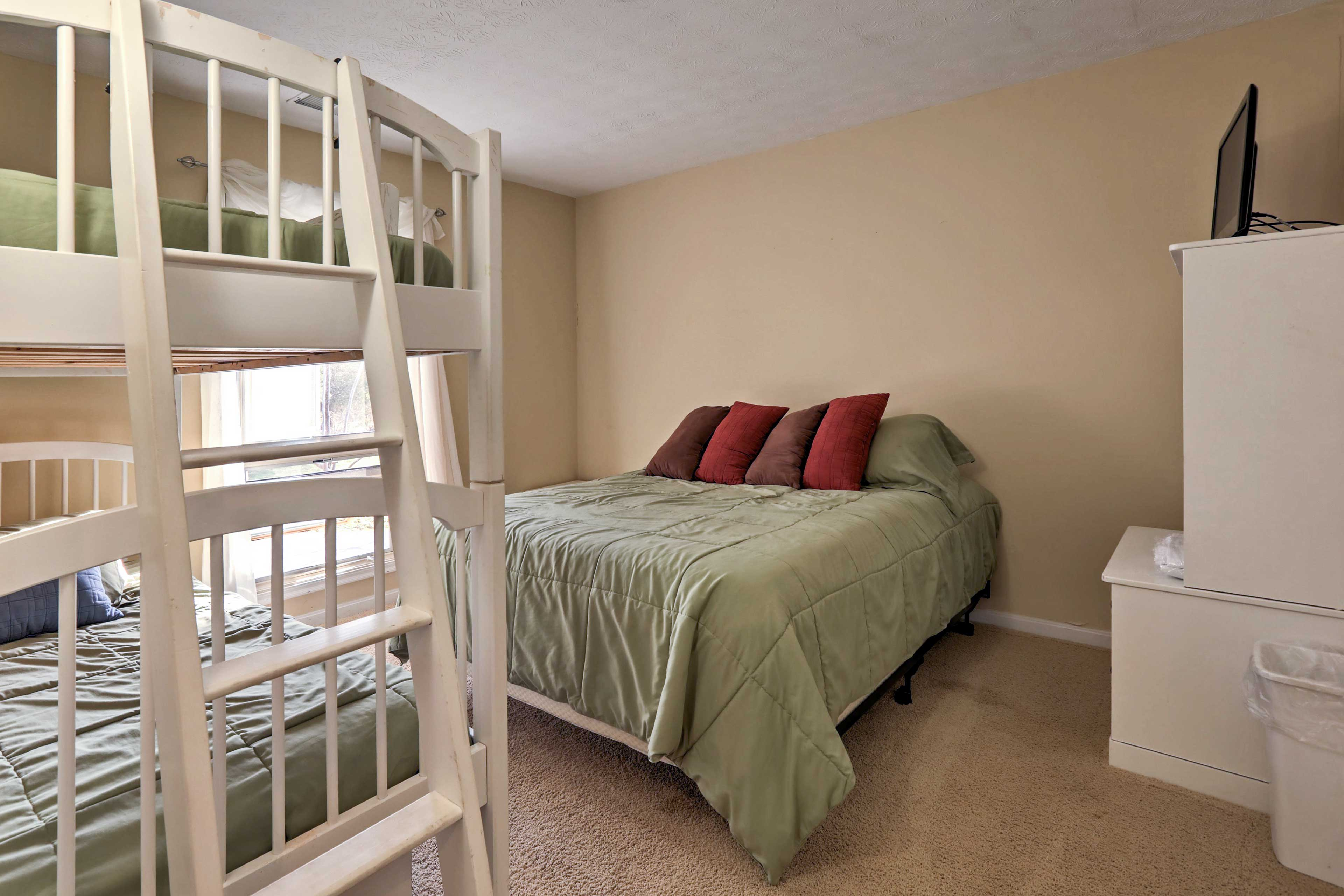 A comfy queen-sized bed and twin bunk offer ample sleeping space.