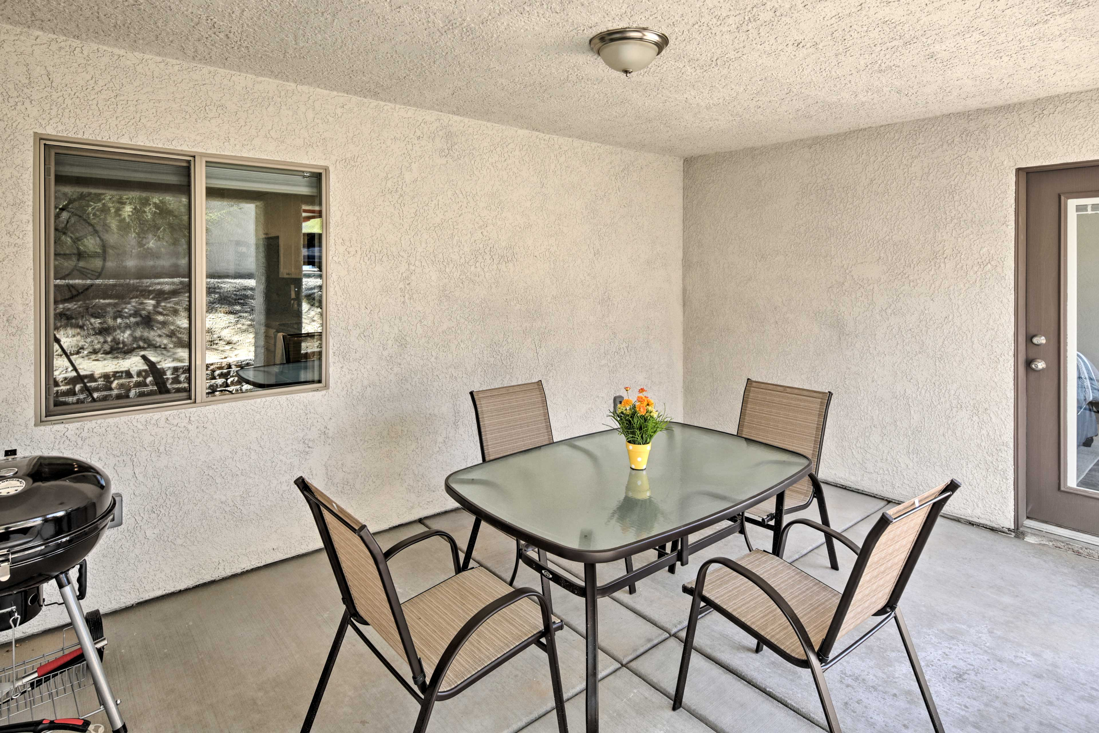 On sunny days, retreat to the shade of the private covered patio.