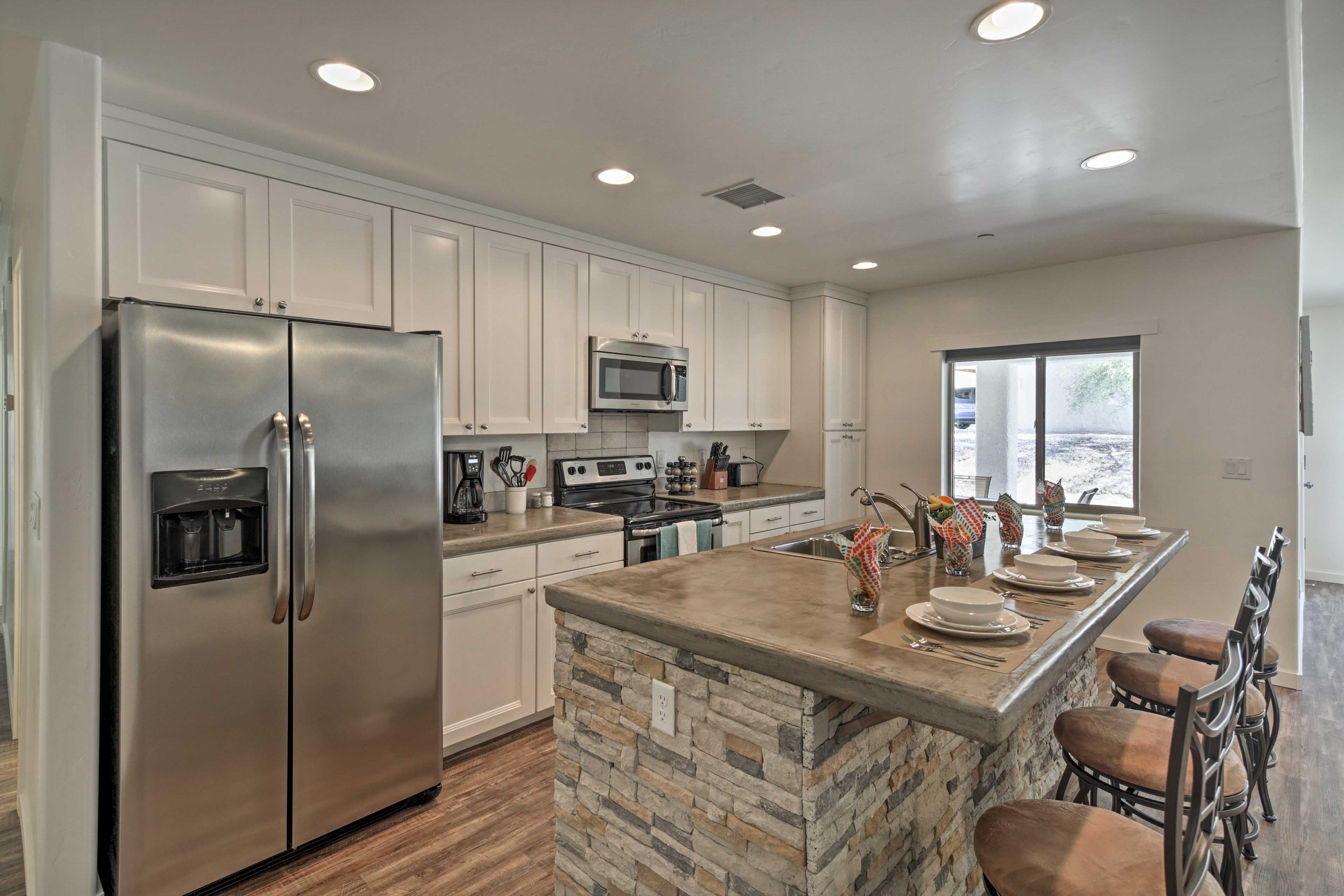 Wine and dine at the 4-person kitchen island.