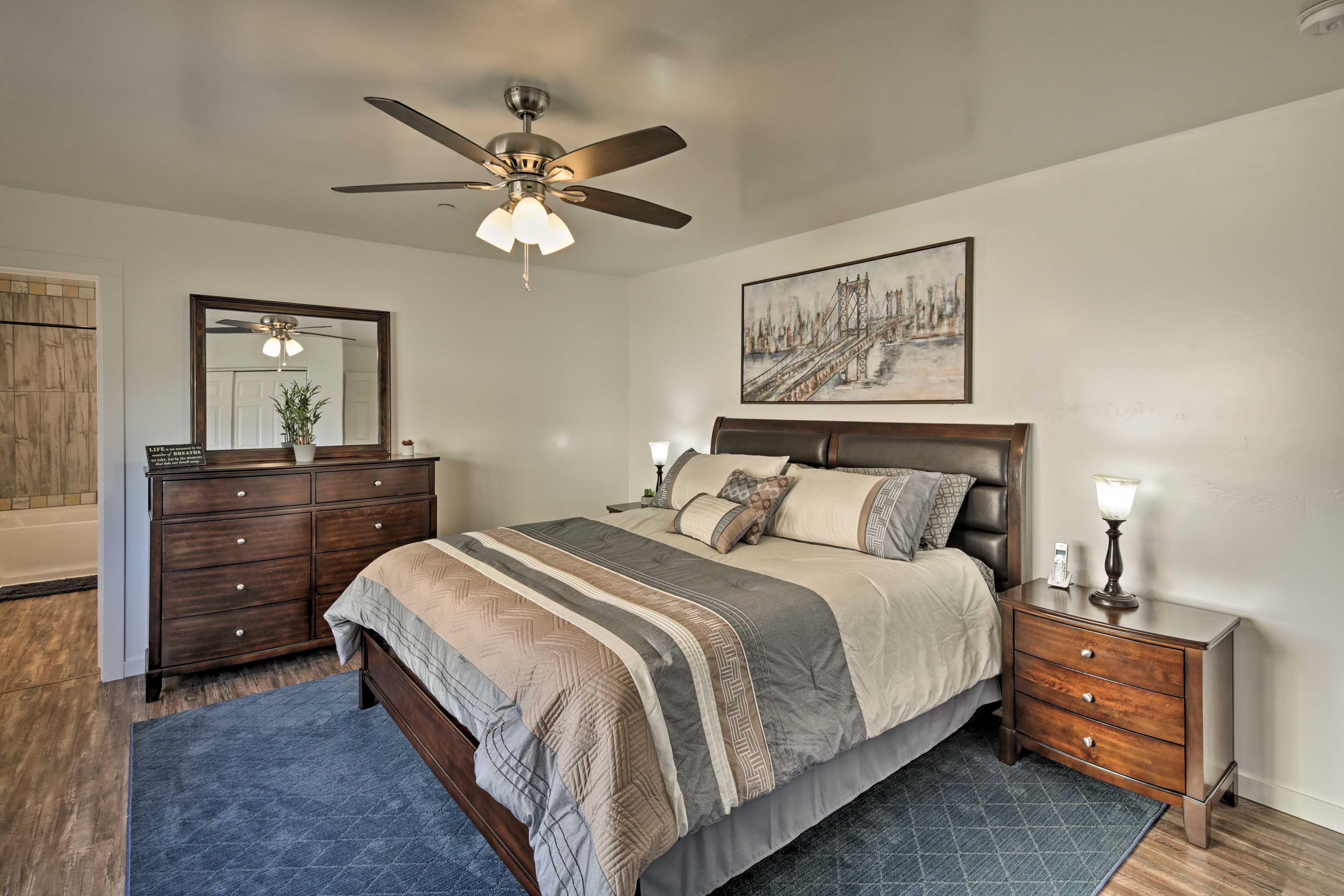 Dream easily in the first bedroom furnished with a plush California king bed.