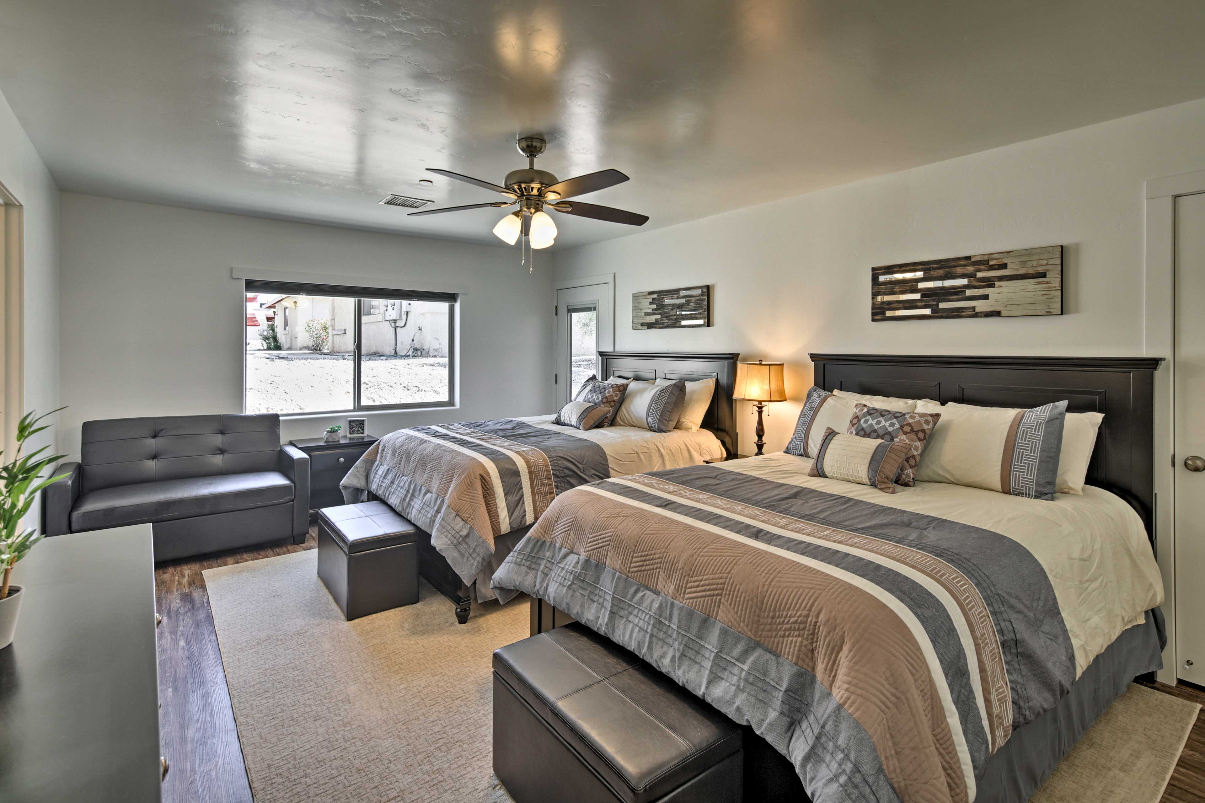 The second bedroom with 2 queen beds & a twin sleeper sofa is great for families.
