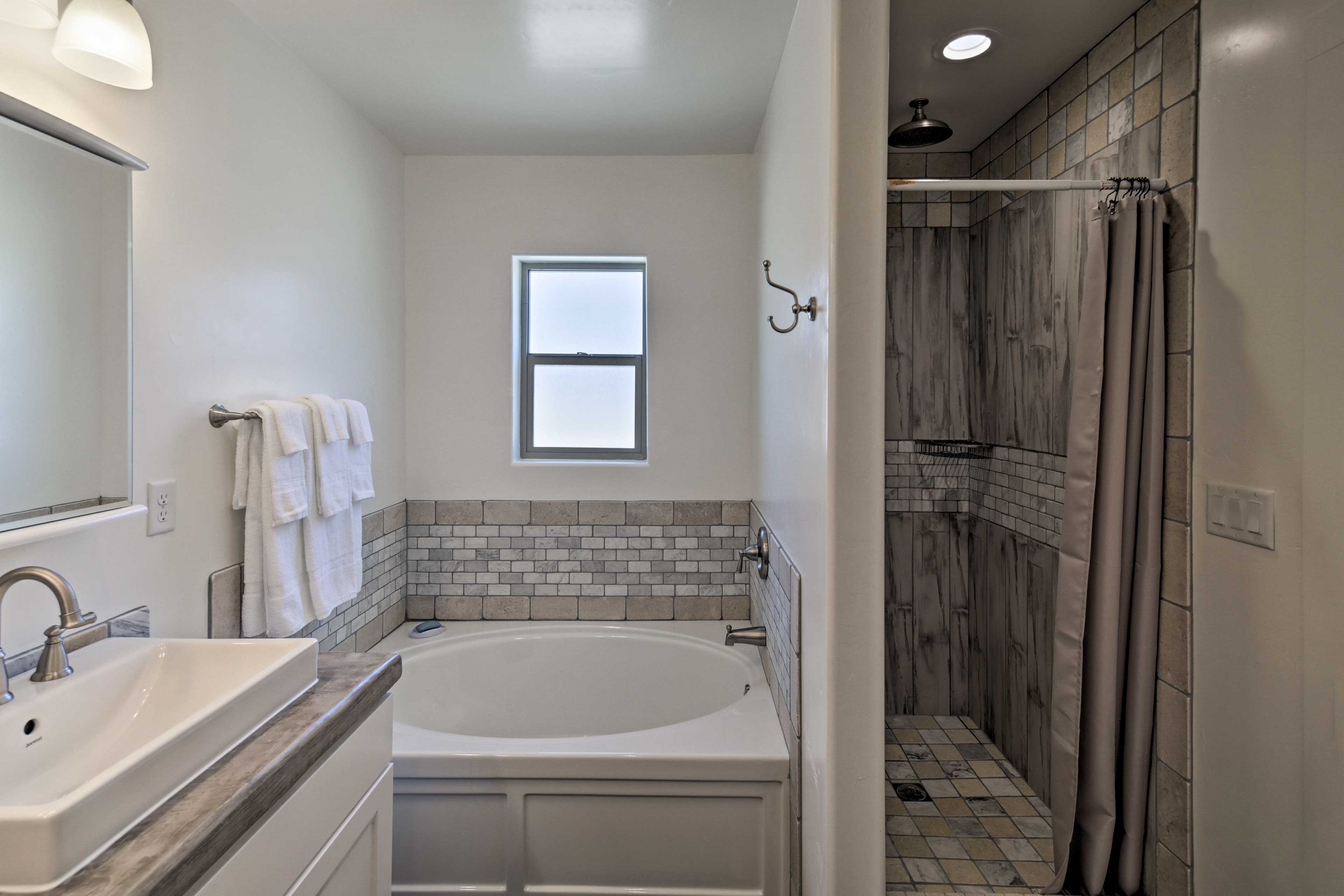 Savor a moment of relaxation in the second bathroom's lavish garden tub.