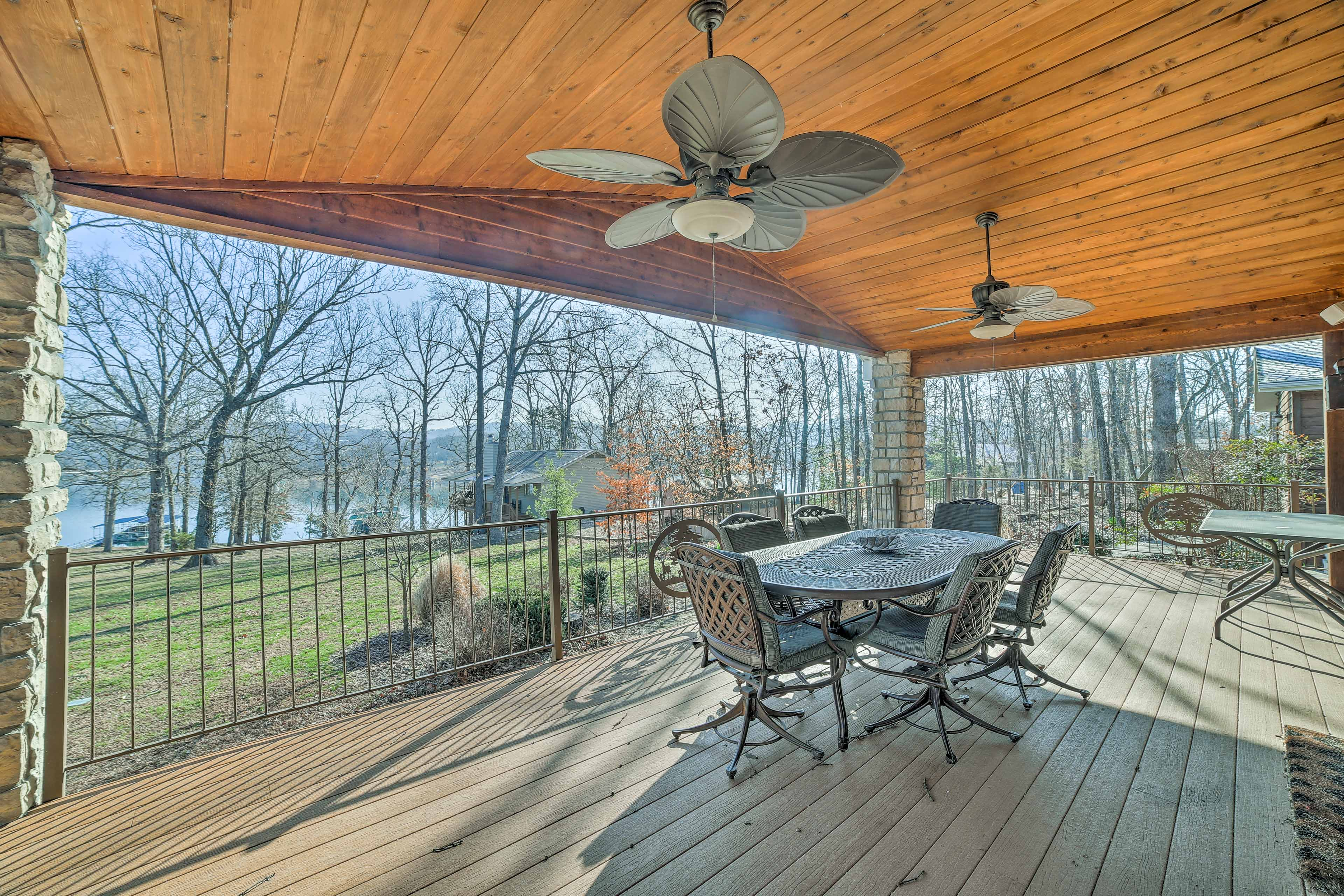 This beautiful Reeds Spring vacation rental home has a spacious wraparound deck.