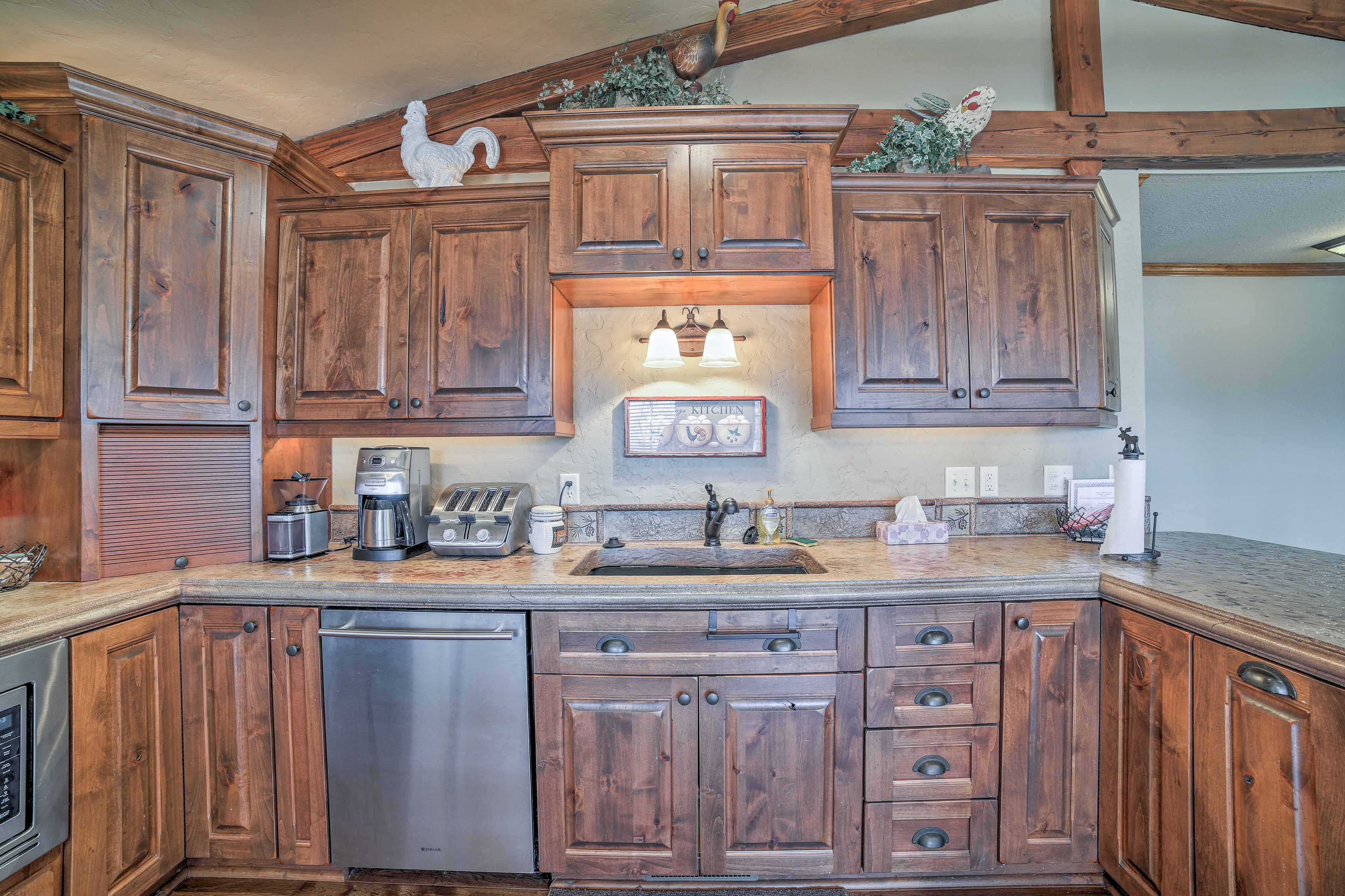 Stately wood cabinetry and granite counters give the kitchen an air of elegance.