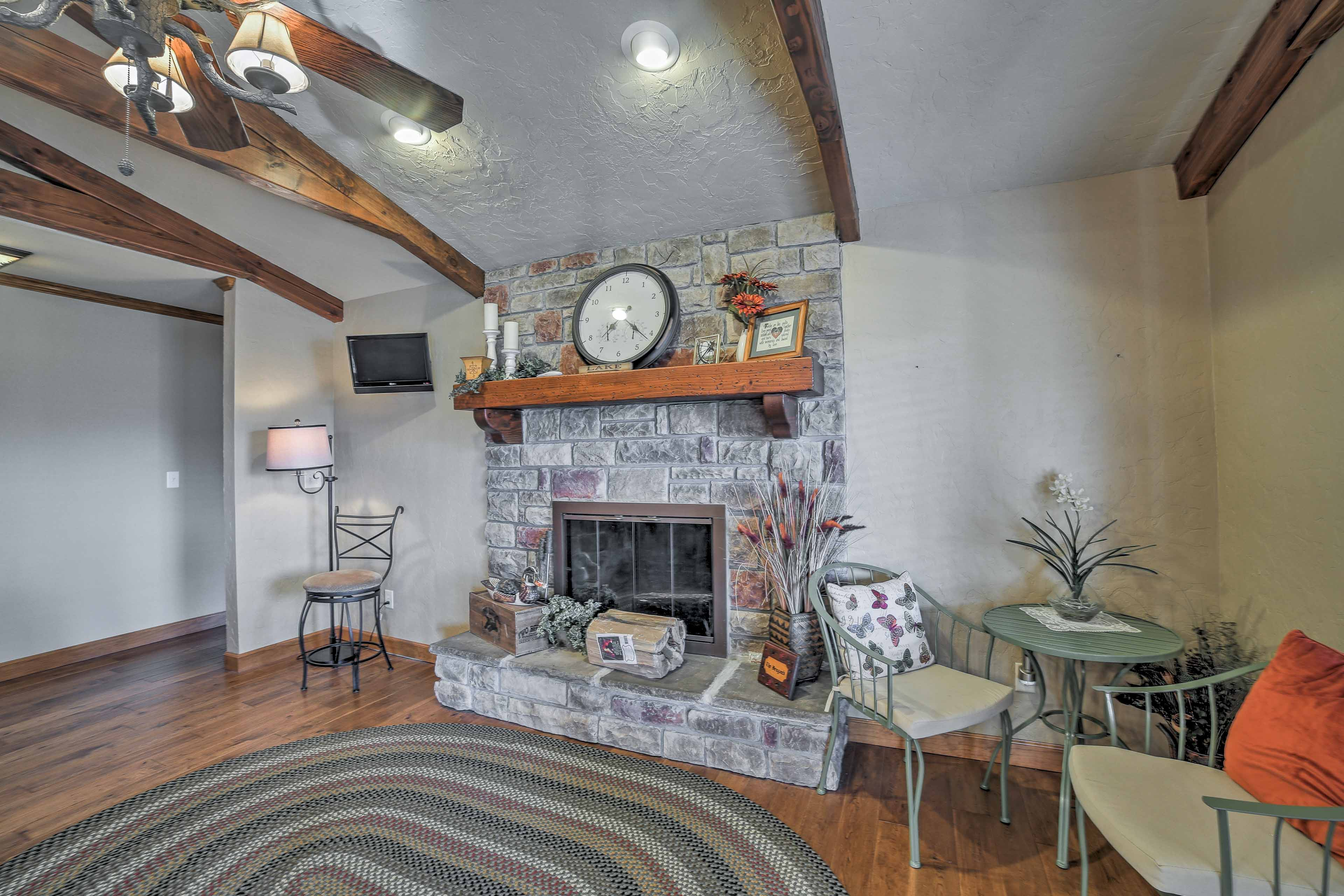 Relax after dinner in the cozy family room by the stone-encased fireplace.