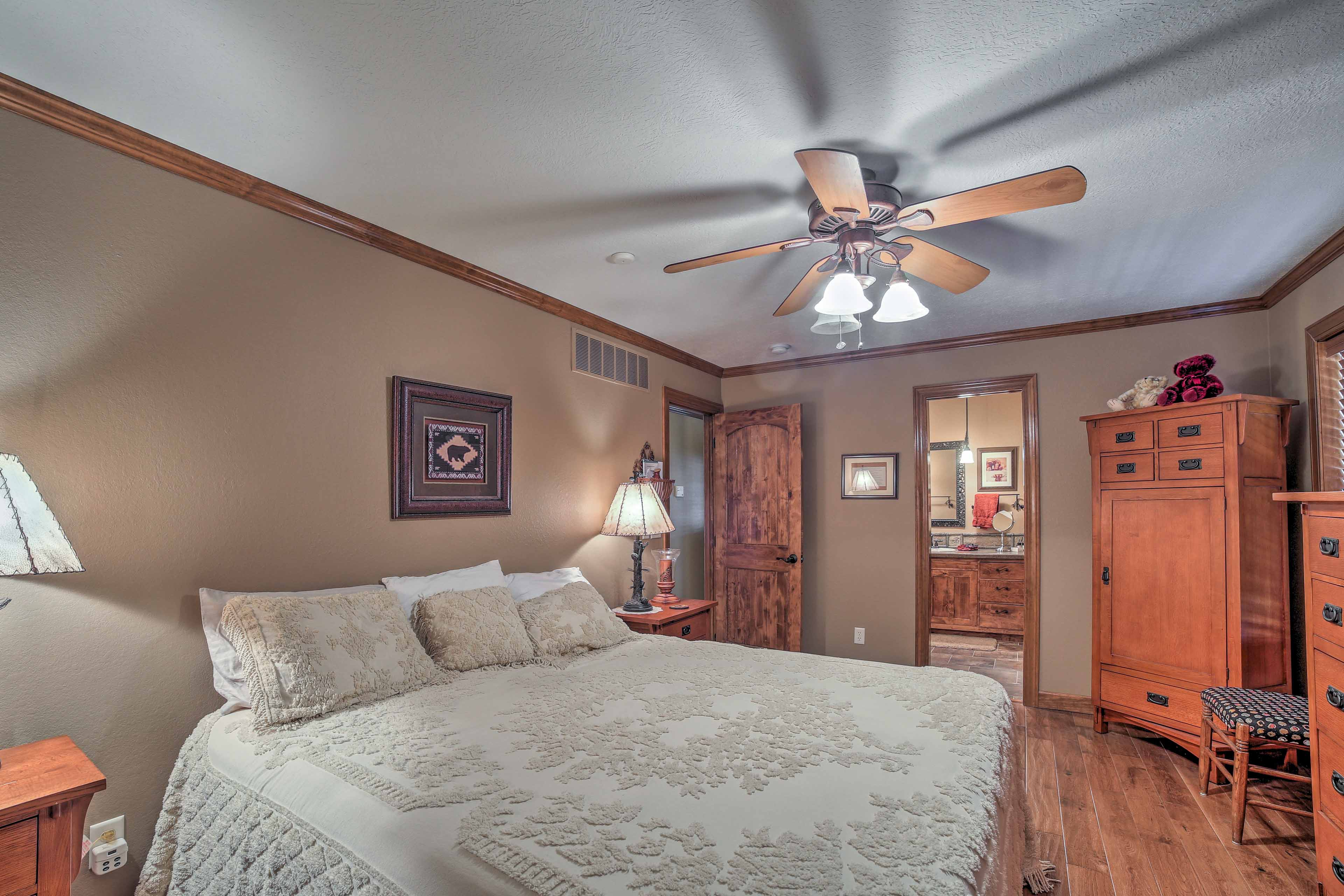 Wood furnishings make the bedroom homey and inviting, with space to unpack.