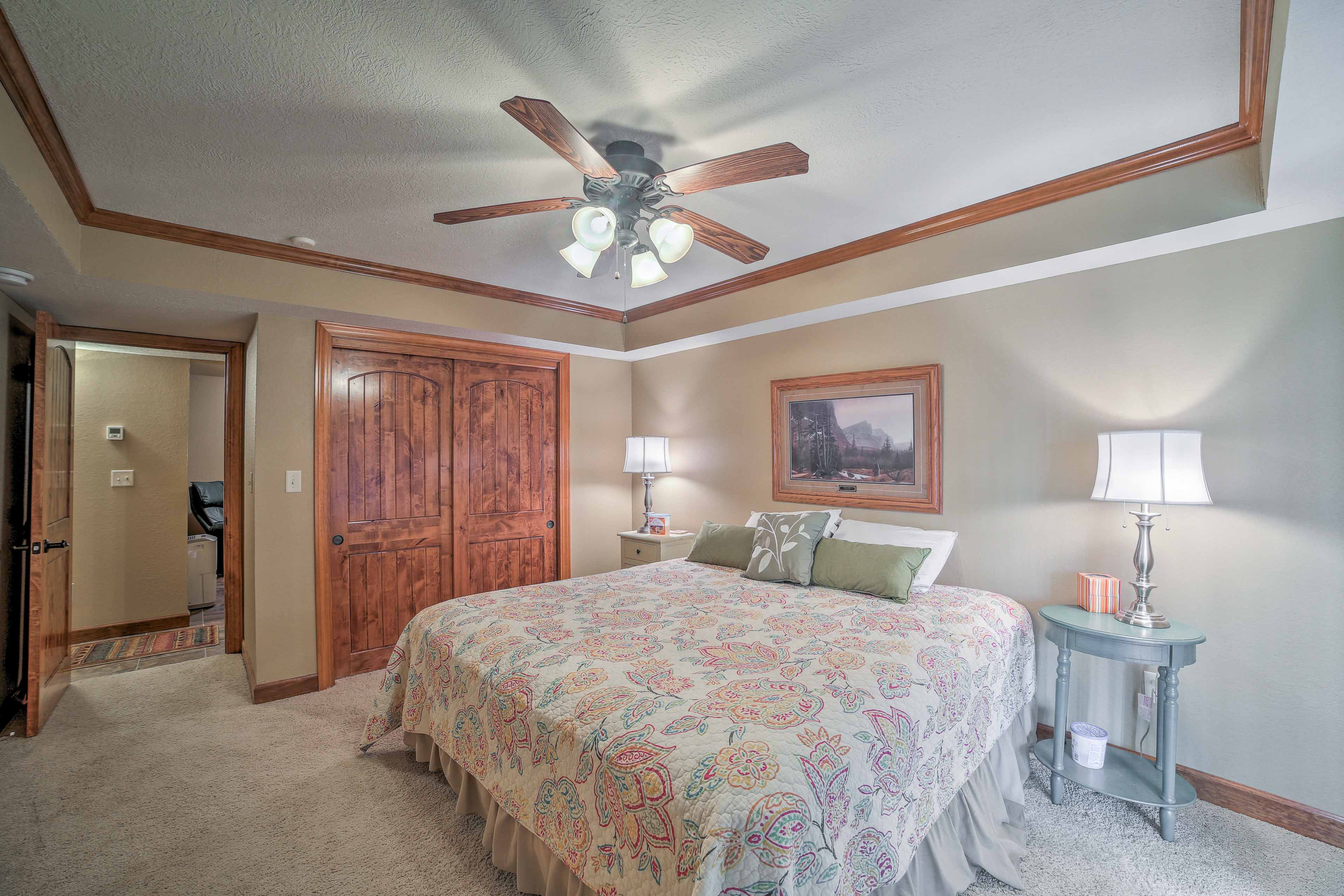 A large closet and door to the patio complete this room with a queen-size bed.