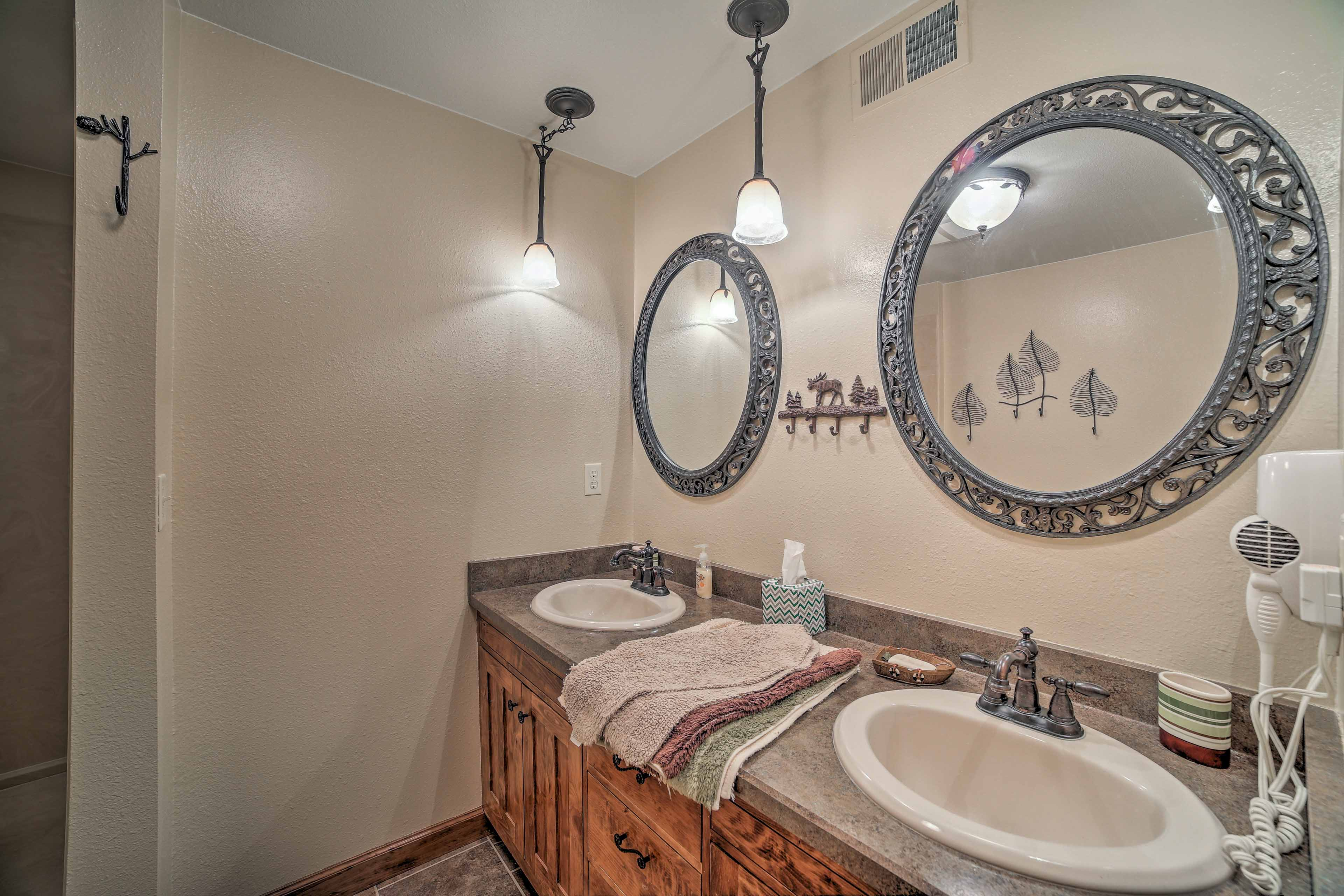 The shared bathroom has plenty of room with 2 sinks and a walk-in shower.