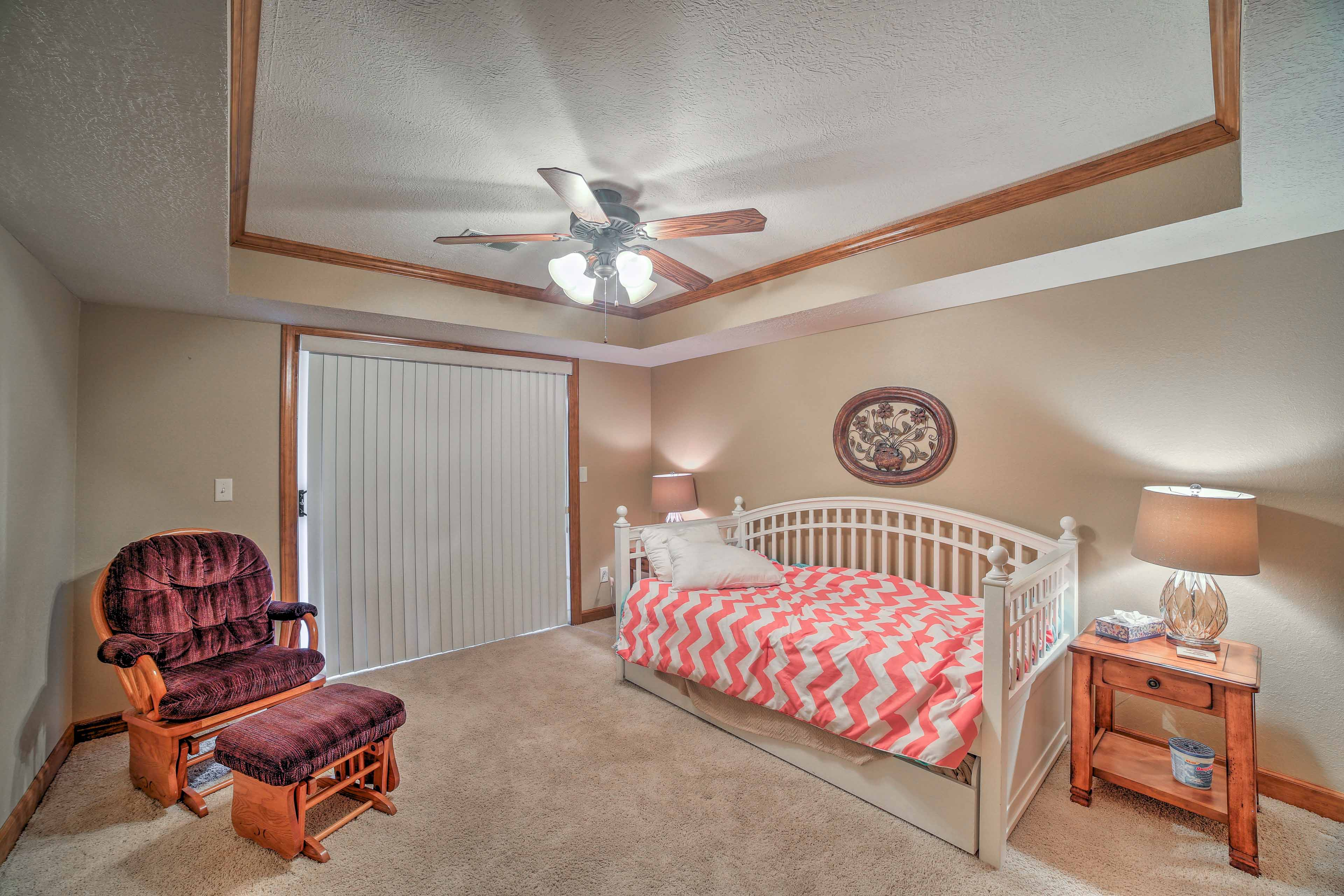 Glass doors lead out to the balcony in this bright room with a twin trundle bed.