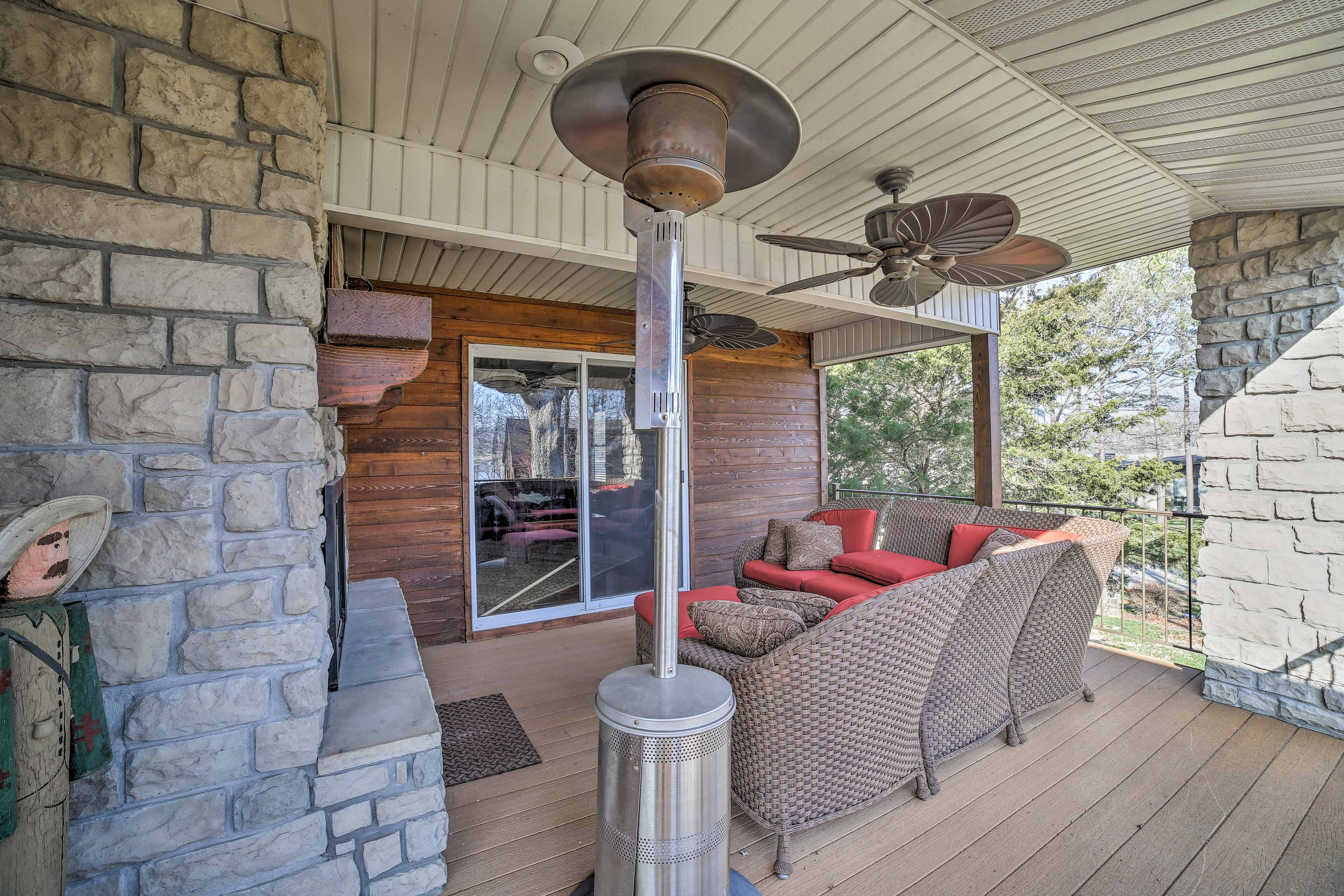 Enjoy the deck year-round with heaters framing the outdoor patio couches.