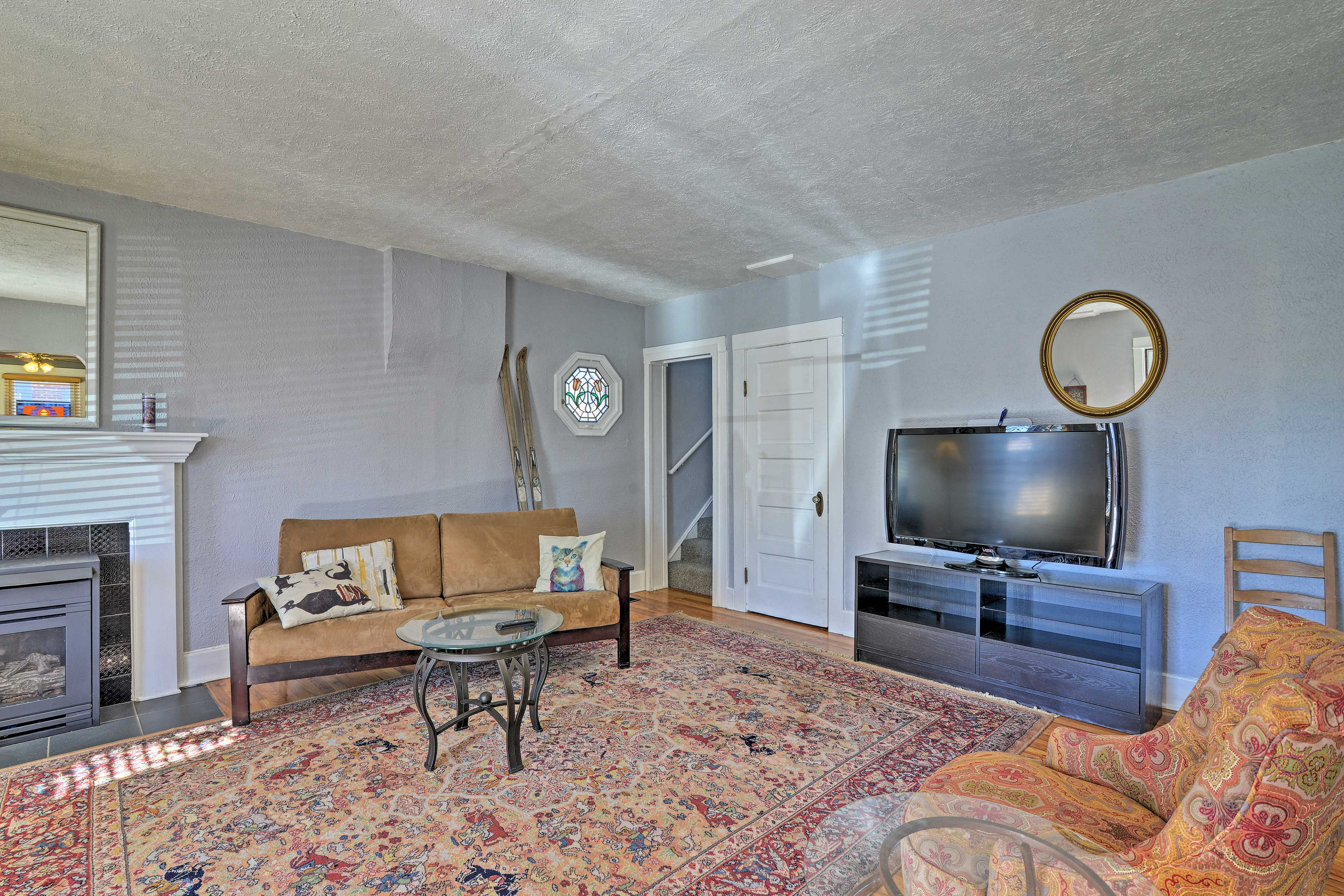 The living room has a flat-screen TV and a gas fireplace.