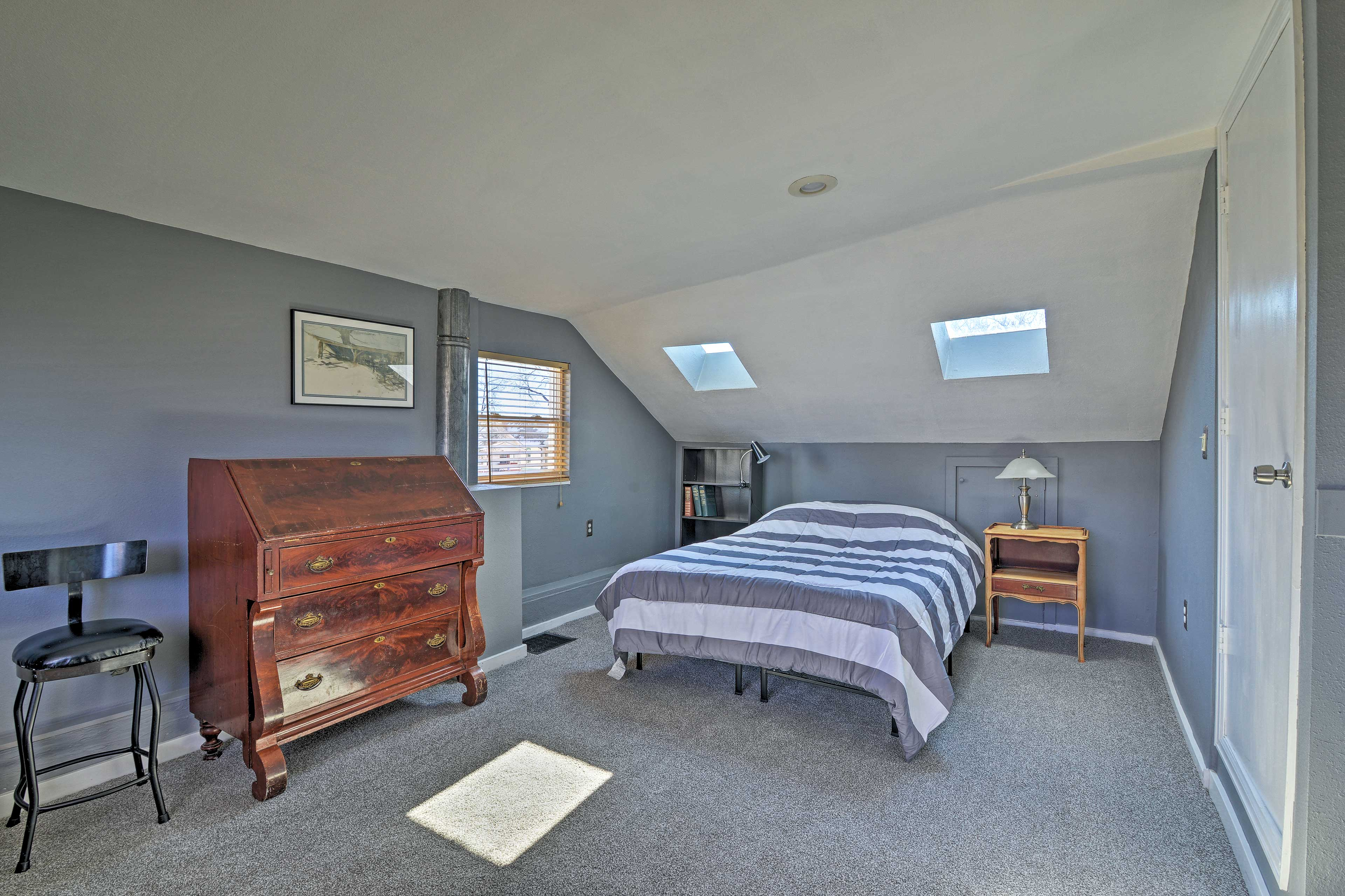 The master bedroom offers a comfortable king mattress.