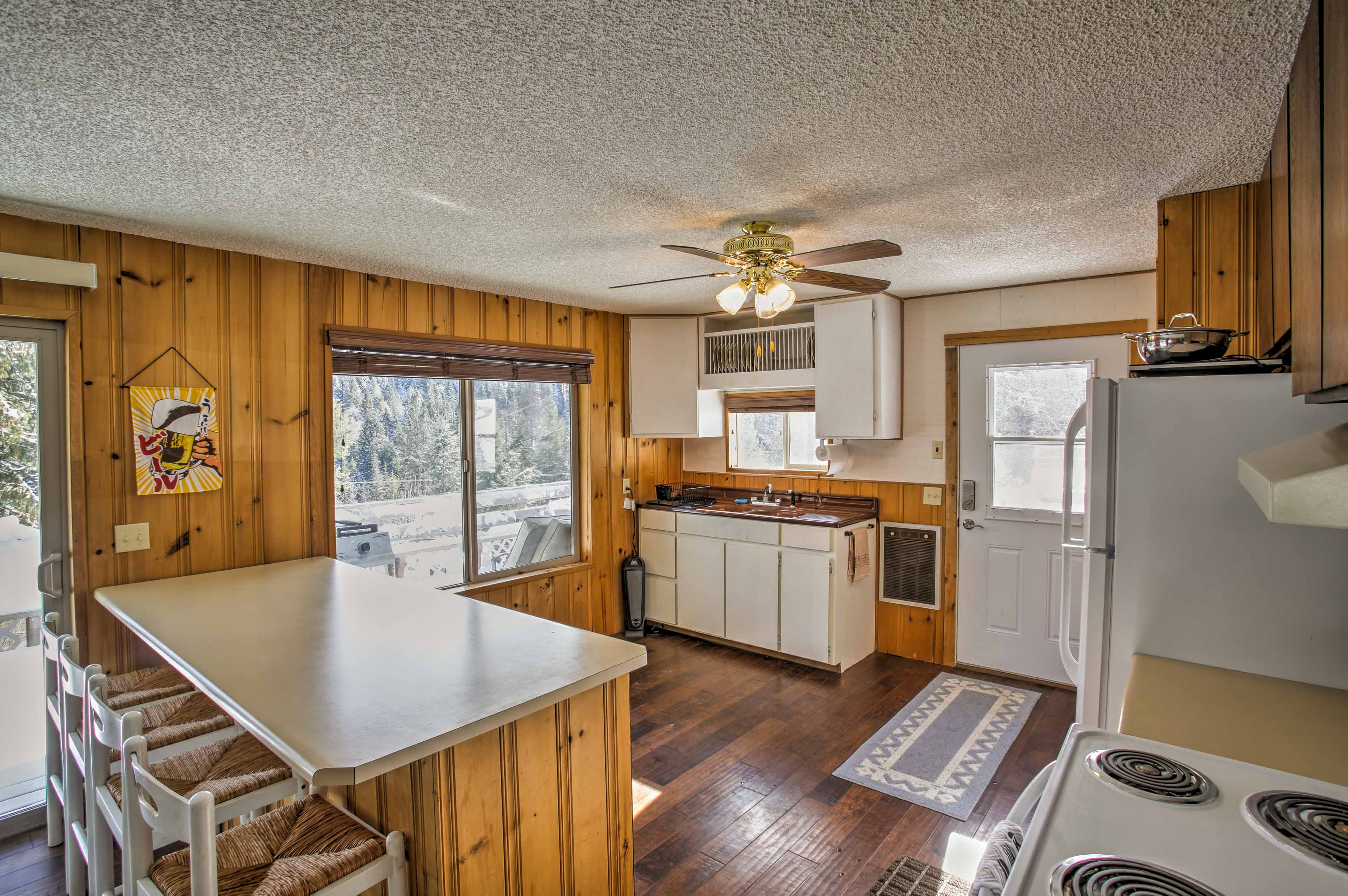 Hardwood floors & numerous windows create a warm and inviting atmosphere.