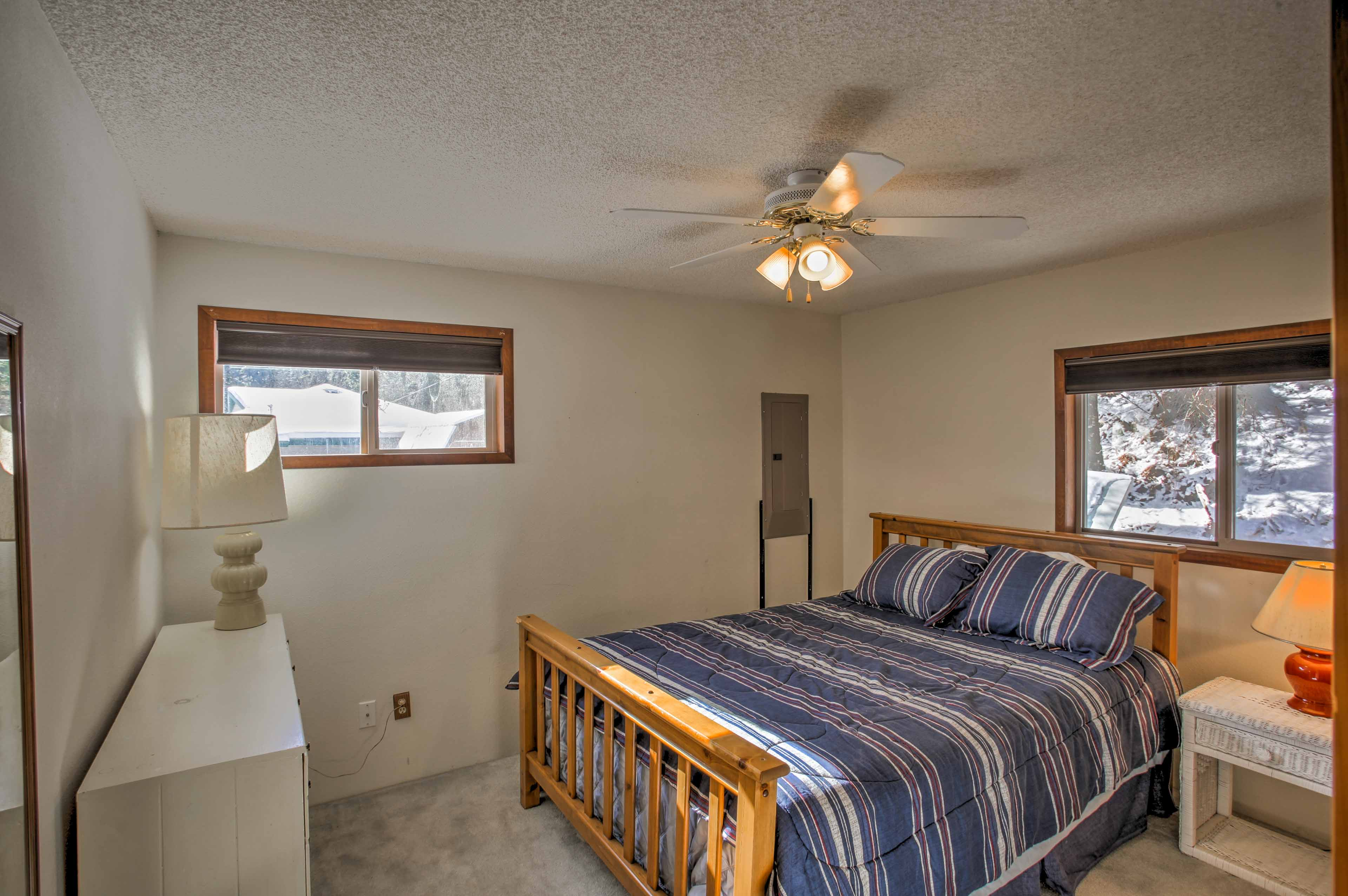 Sleep peacefully in this cozy bedroom with a queen bed.