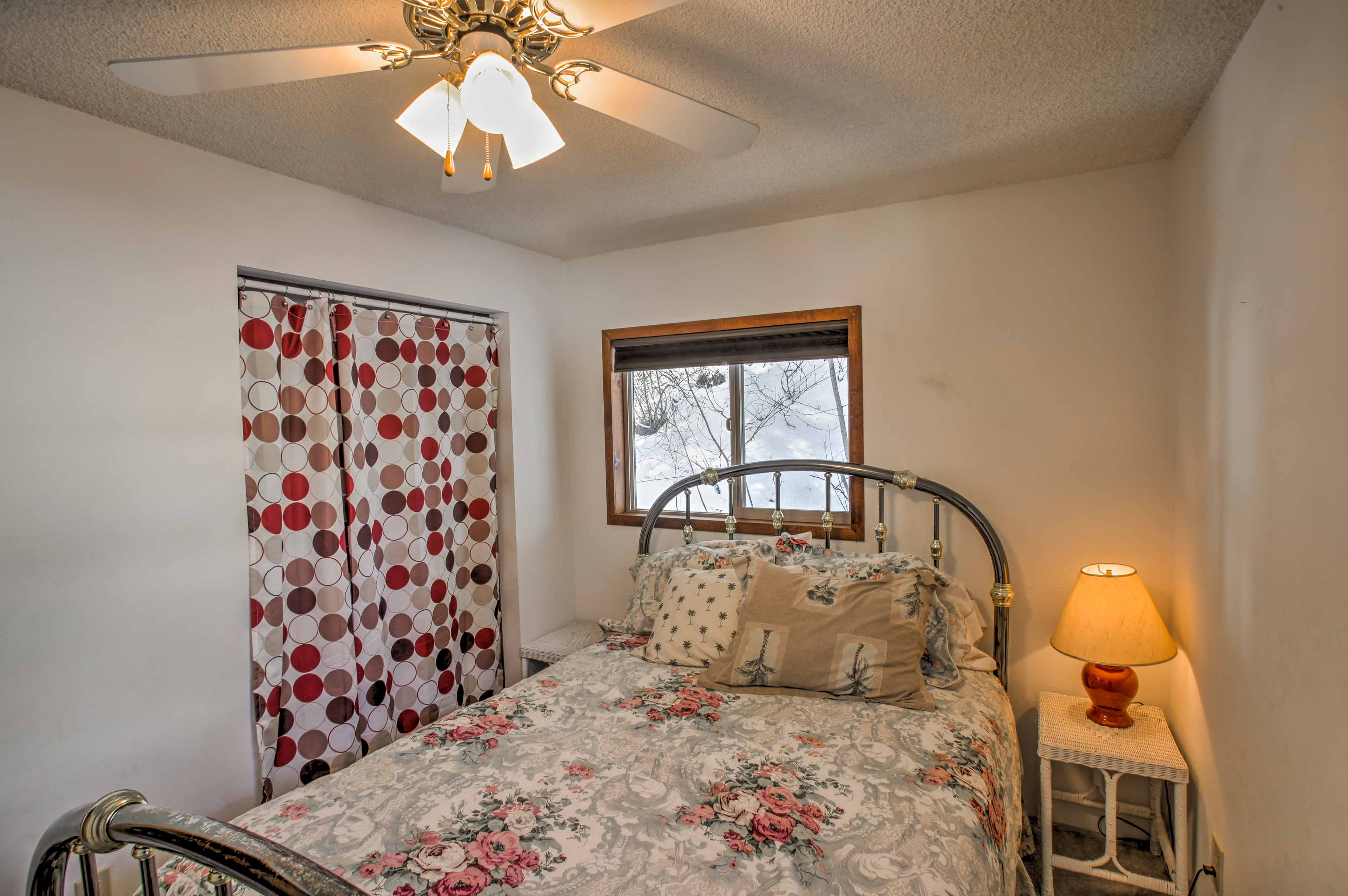 An additional bedroom is furnished with a comfortable queen-sized bed.