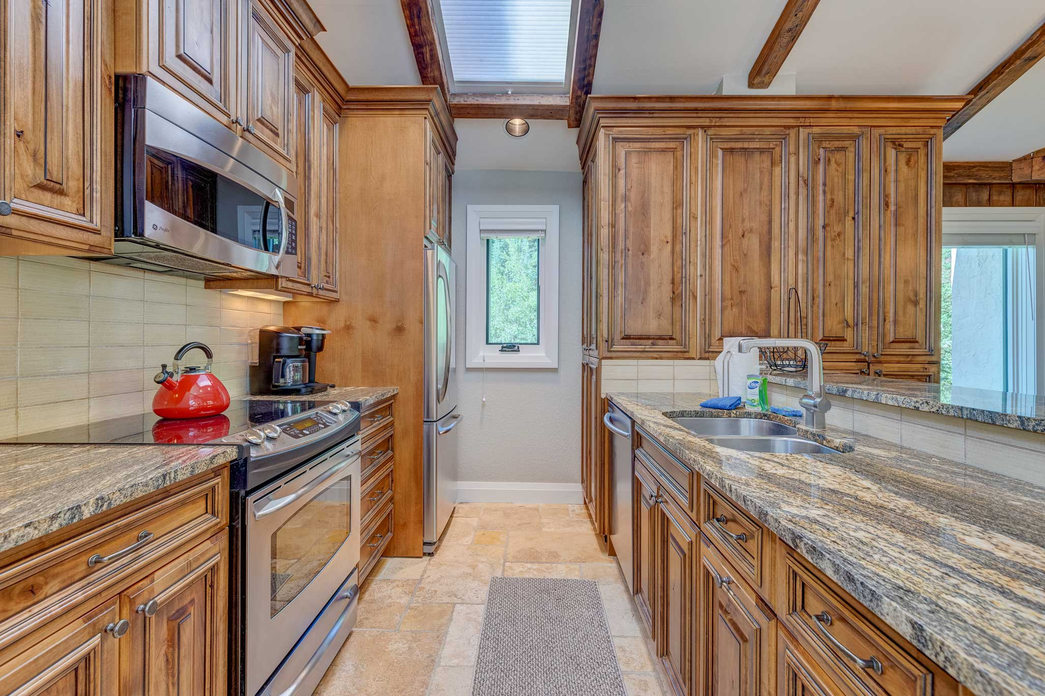 The kitchen boasts stainless steel appliances and Alder cabinetry.