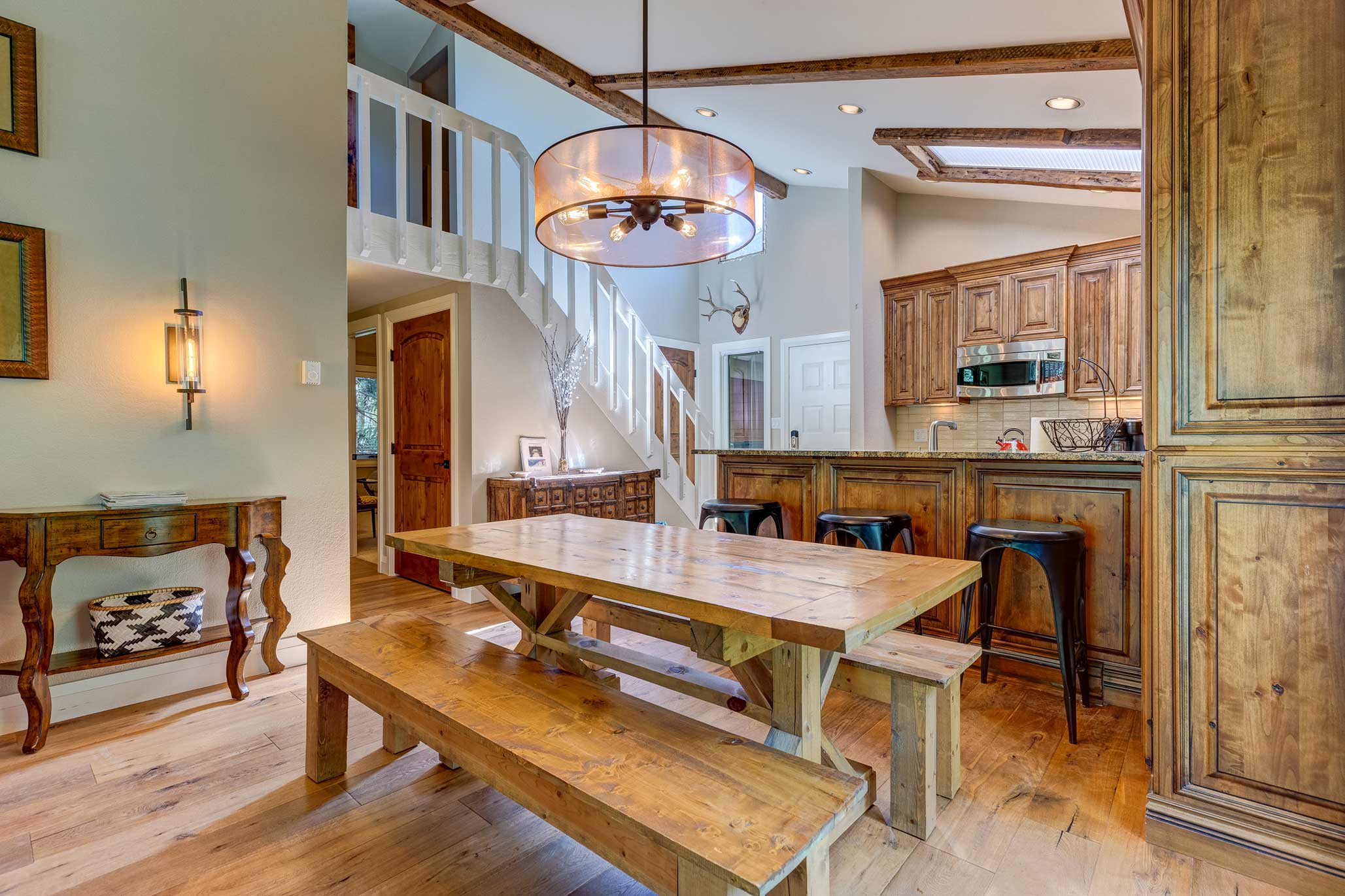 Chow down around this rustic farmhouse table with bench seating.