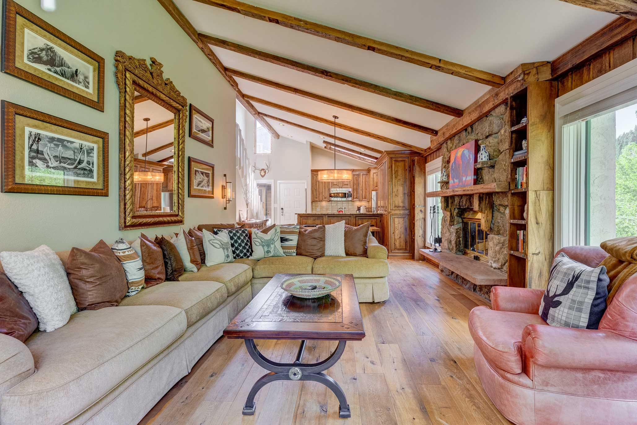 Exposed beams accentuate the vaulted ceilings in the great room.