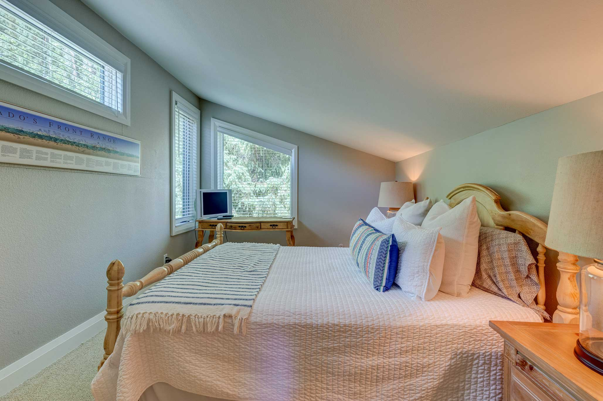 This second suite includes a queen-sized bed.