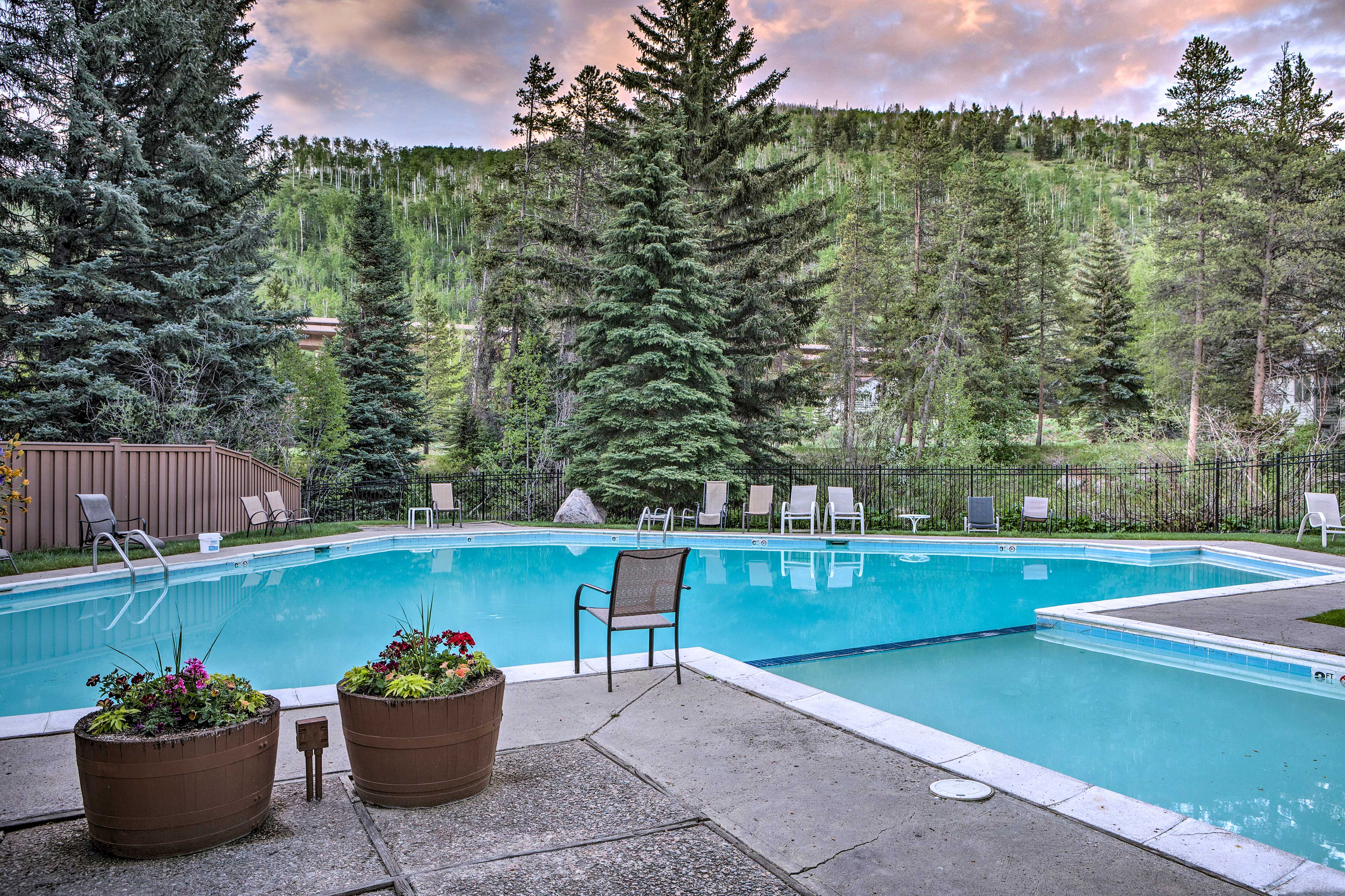 This pool is surrounded by beautiful forest views.