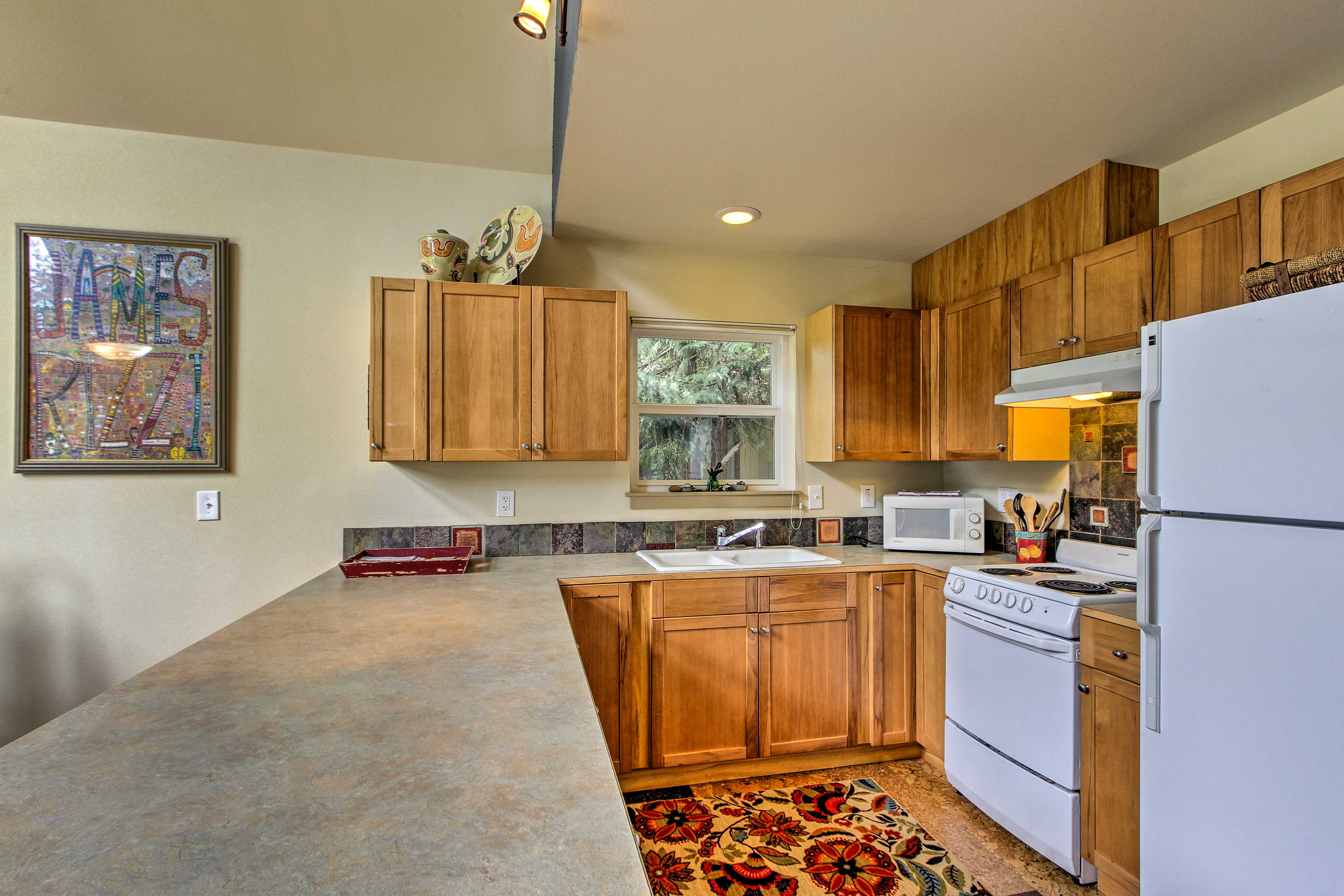 The kitchen is well-equipped with modern appliances.