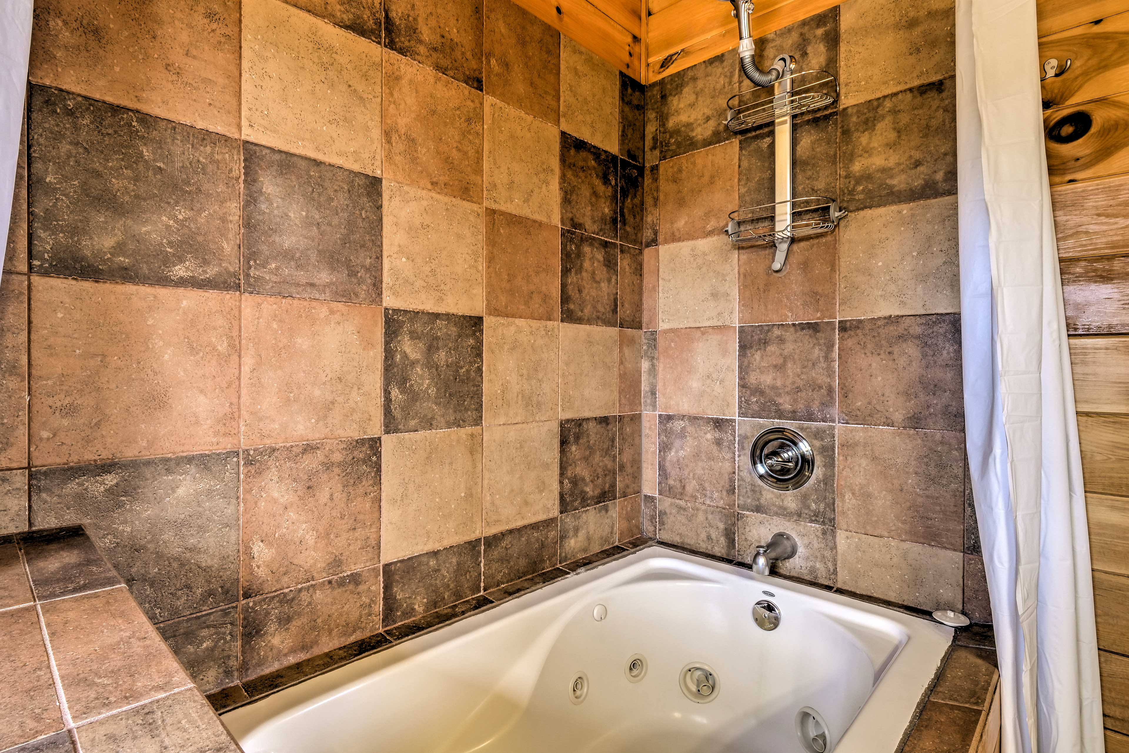 Go for a soak in the luxurious master bathroom.