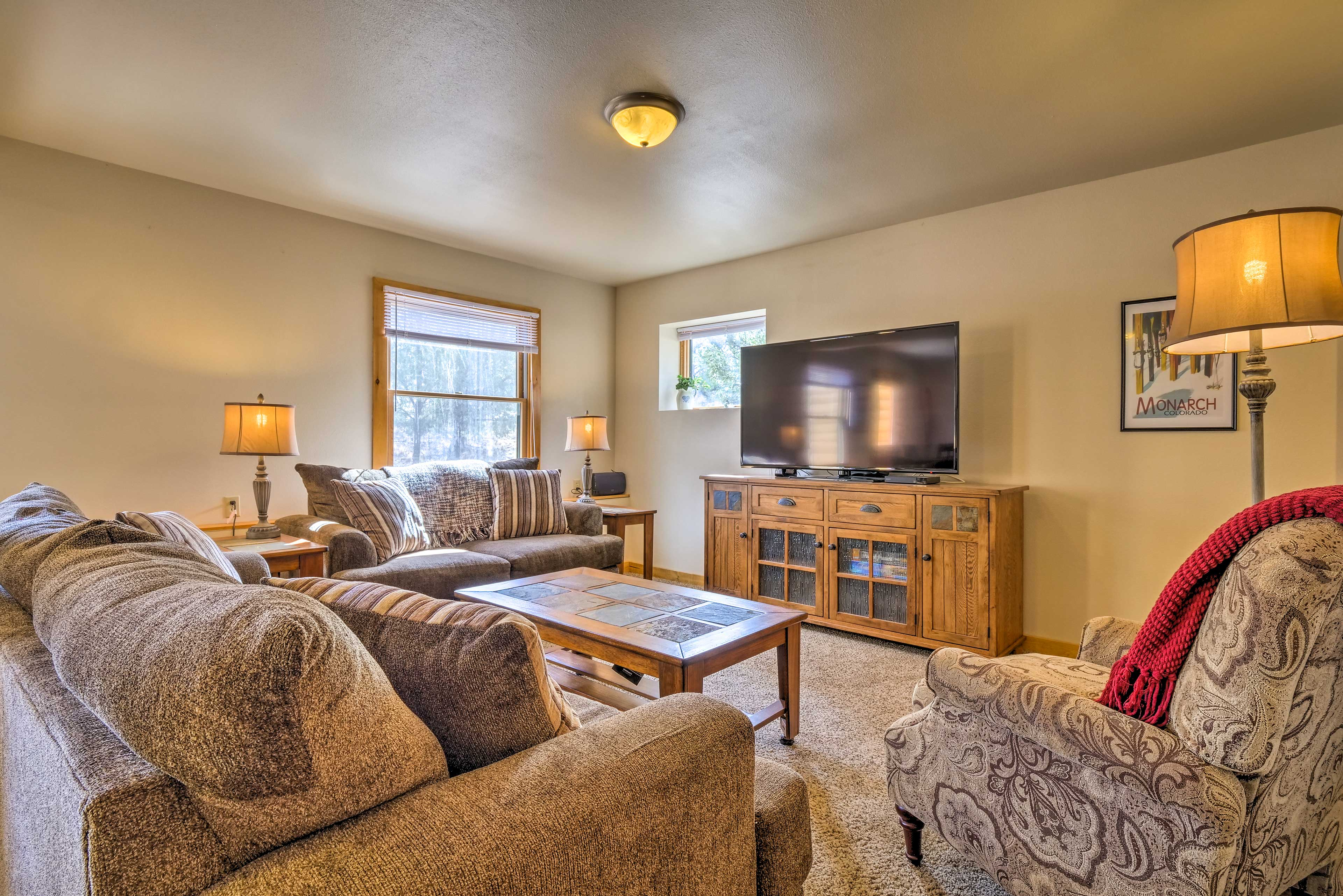 Walk down to the family room in the basement.