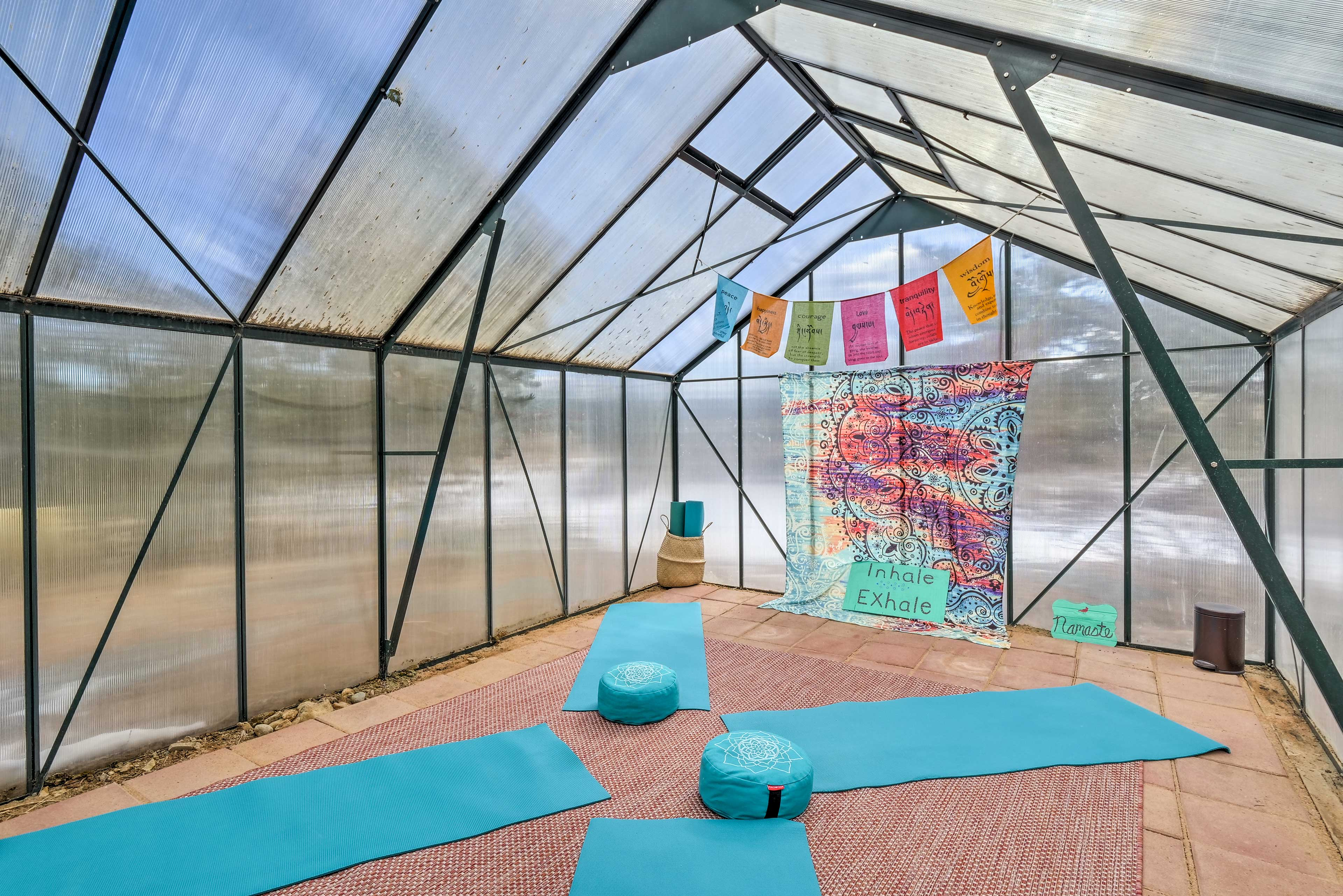 The greenhouse has been converted into a yoga room!