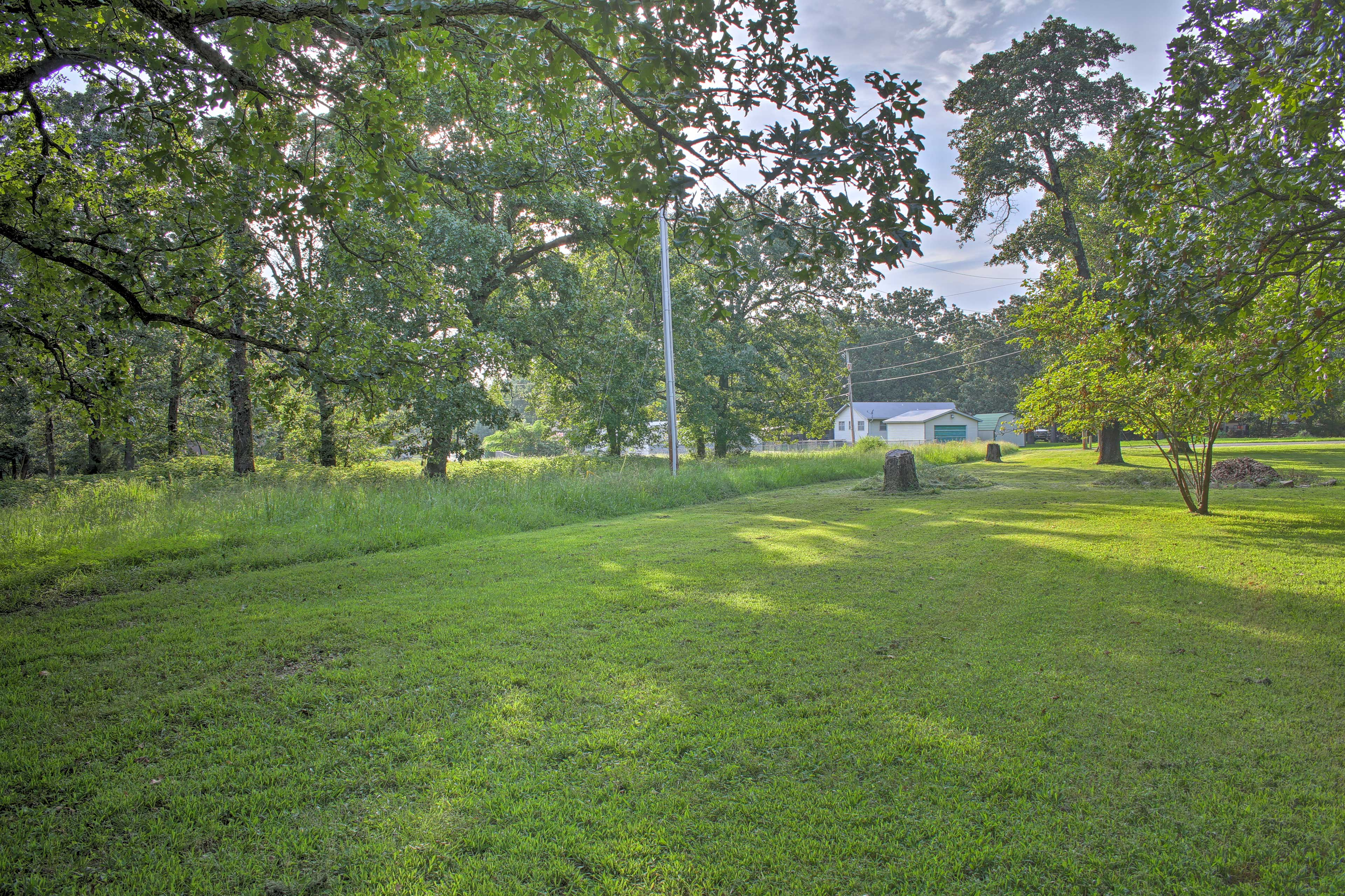 The property is filled with verdant trees and plants.