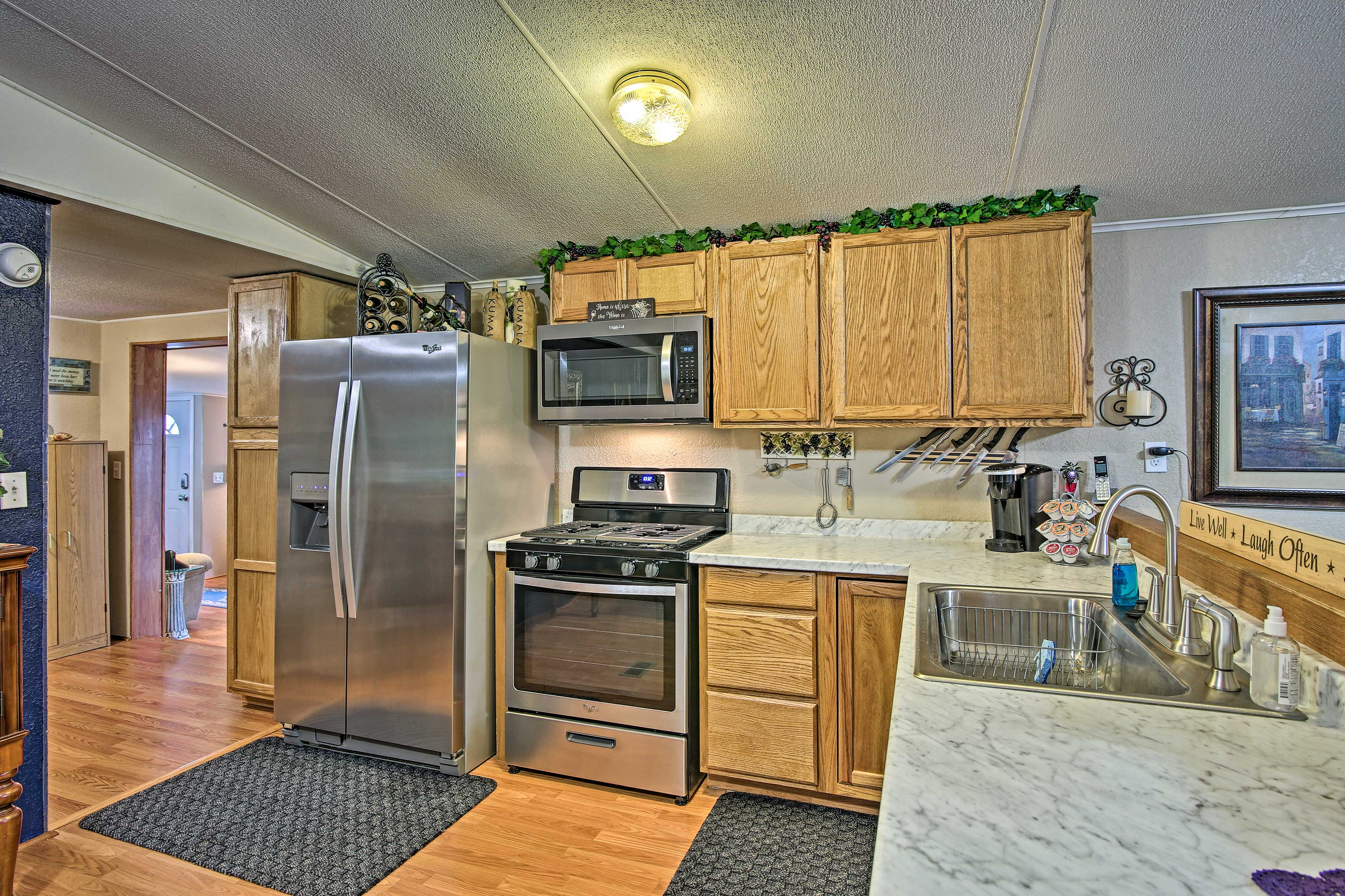 The kitchen is filled with brand new stainless steel appliances.
