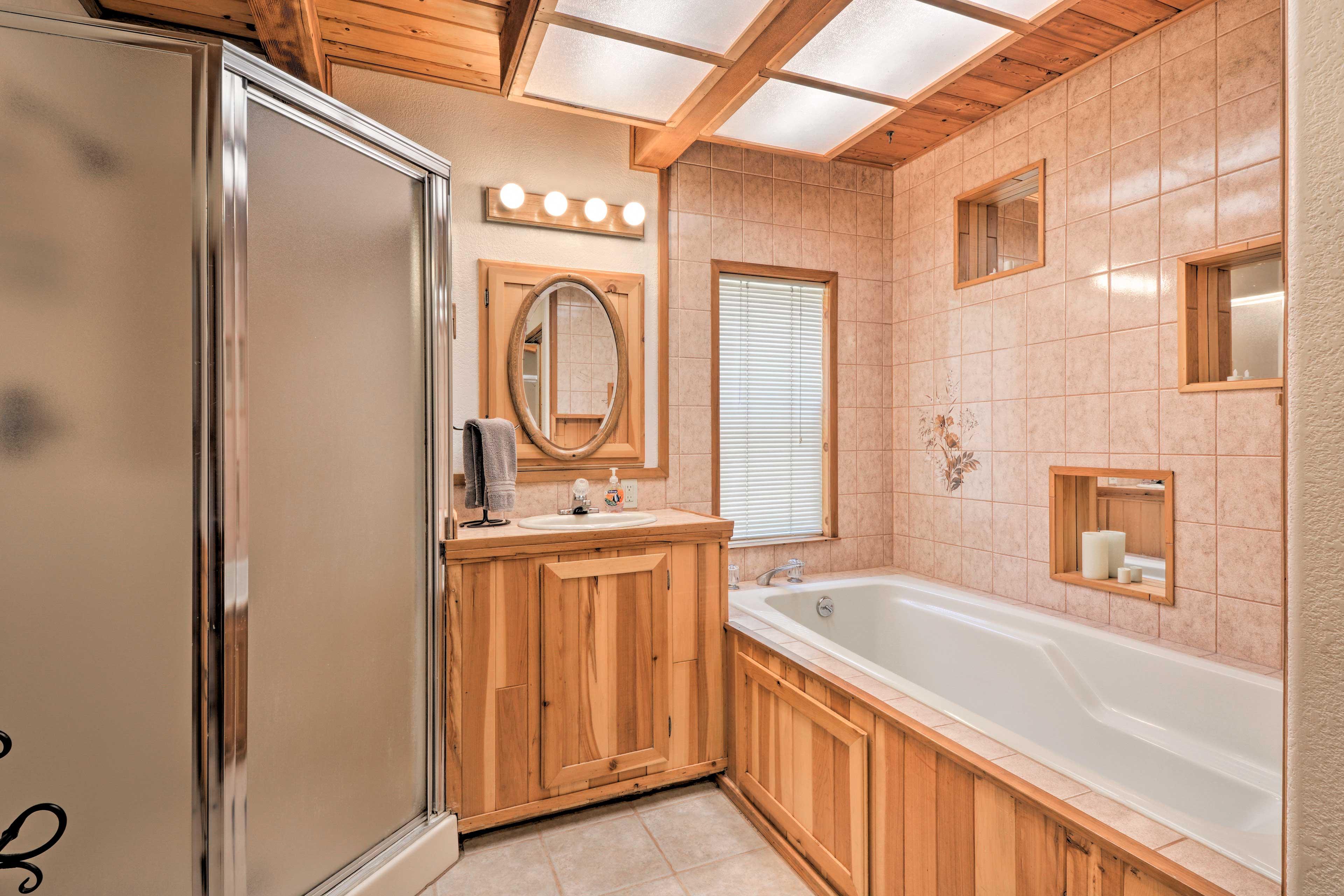 The master bathroom boasts a soaking tub and walk-in shower.