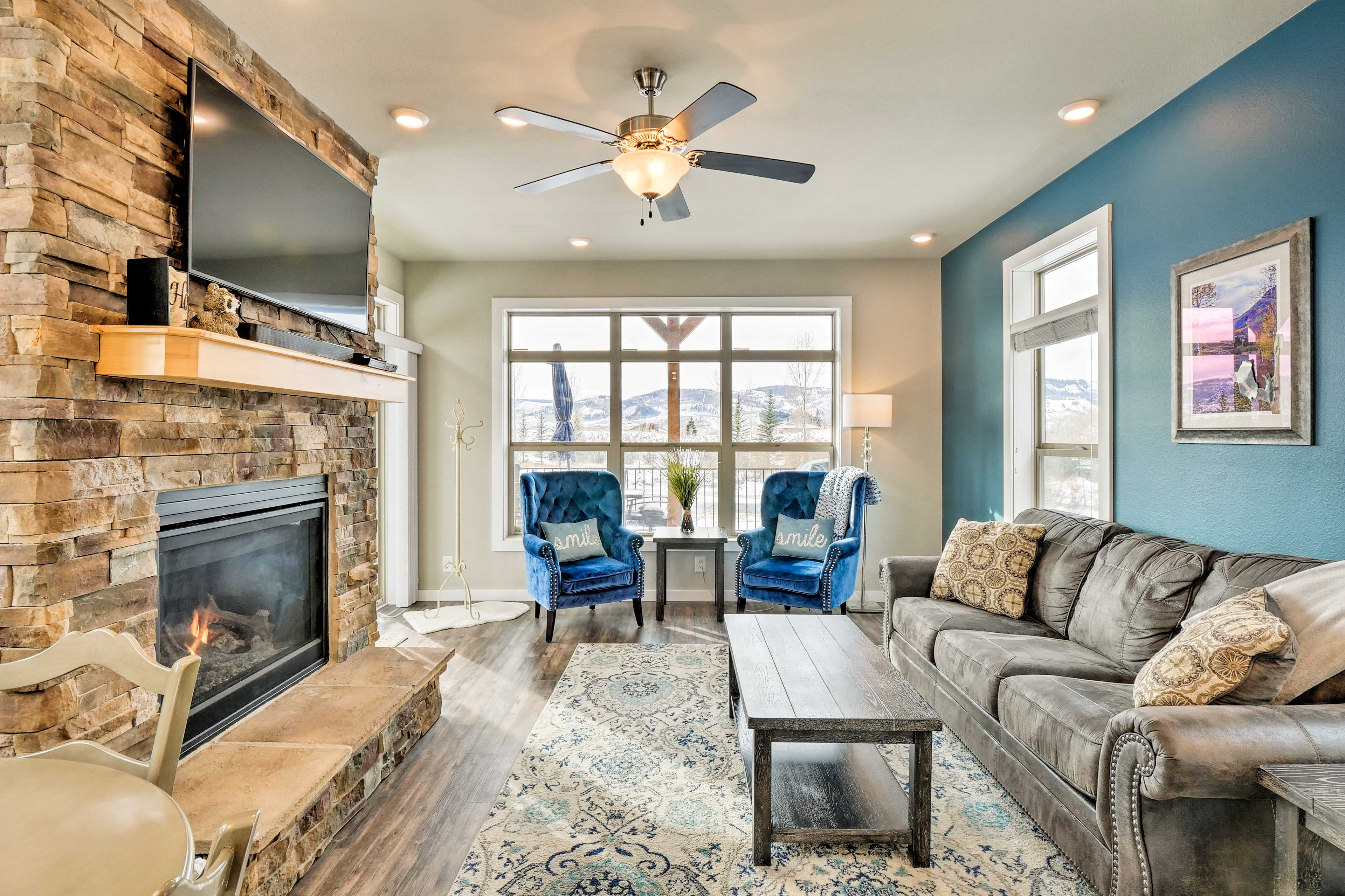 The living room features a gas fireplace and flat-screen TV.