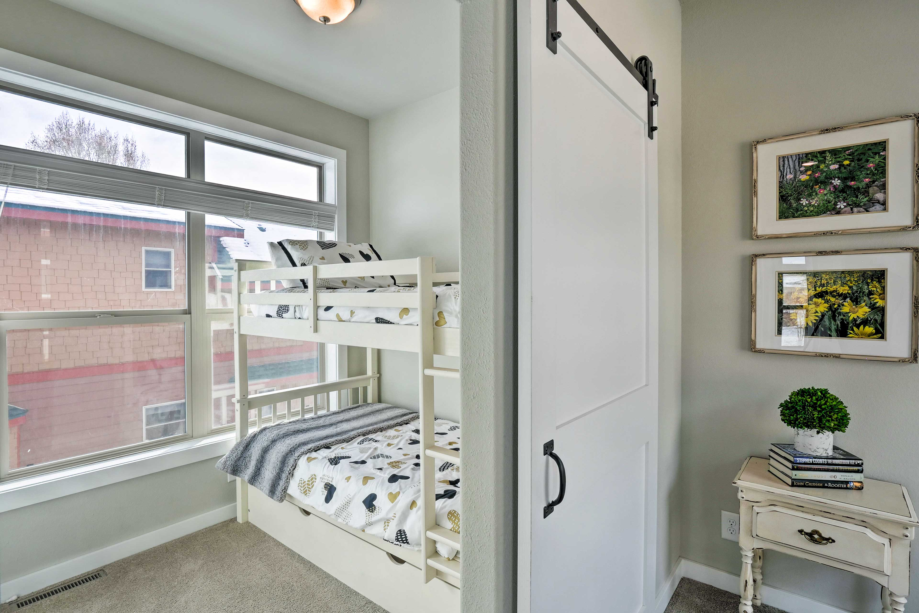 Kids will love sharing this room's twin-over-twin bunk bed and twin trundle bed.