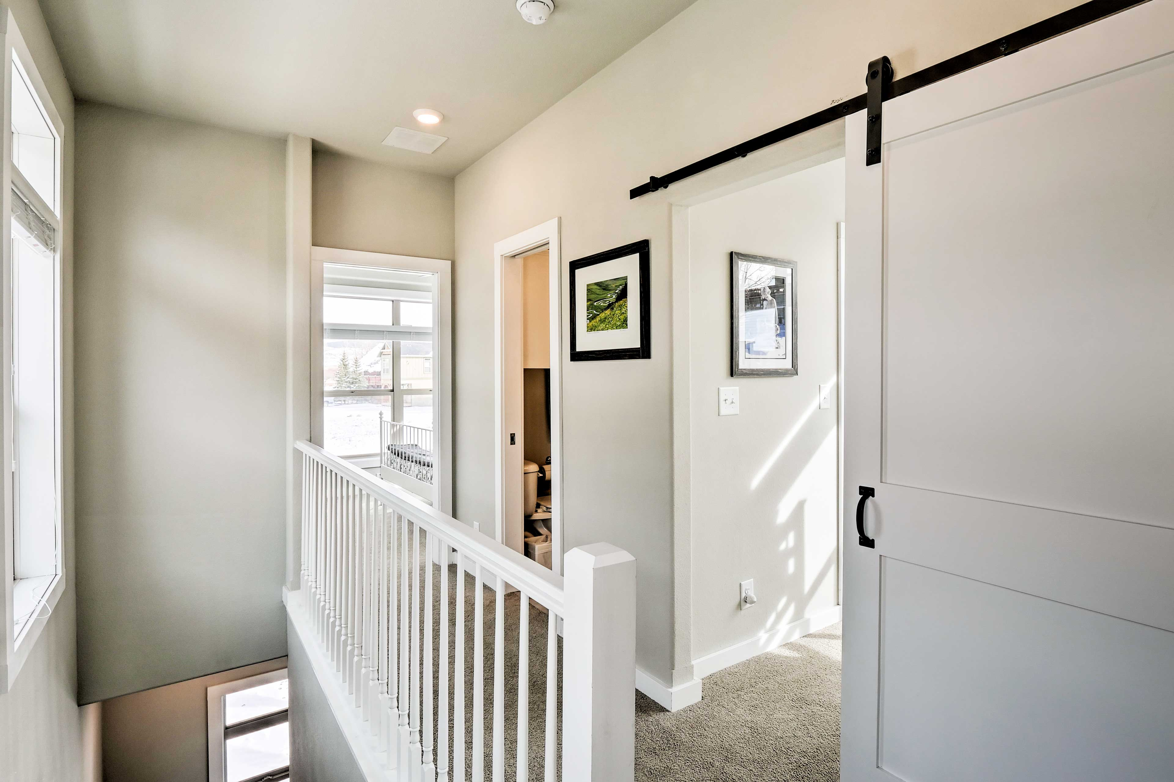 Head upstairs to pick out a bedroom.