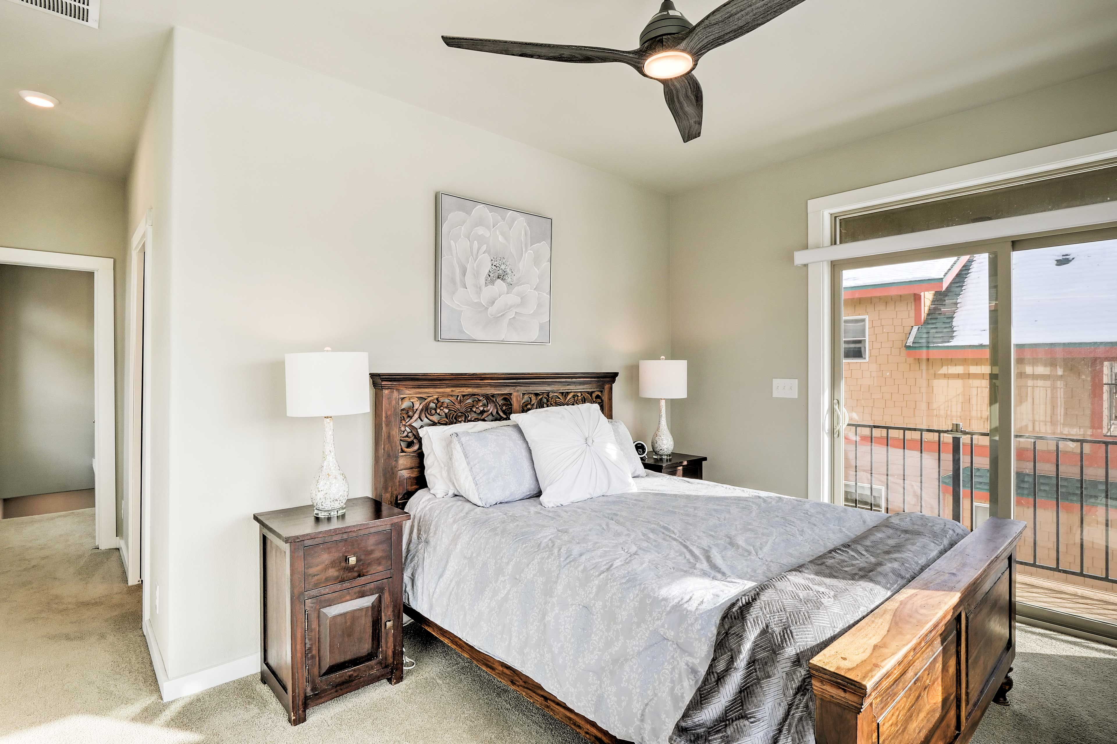 Another queen bed highlights this last bedroom.