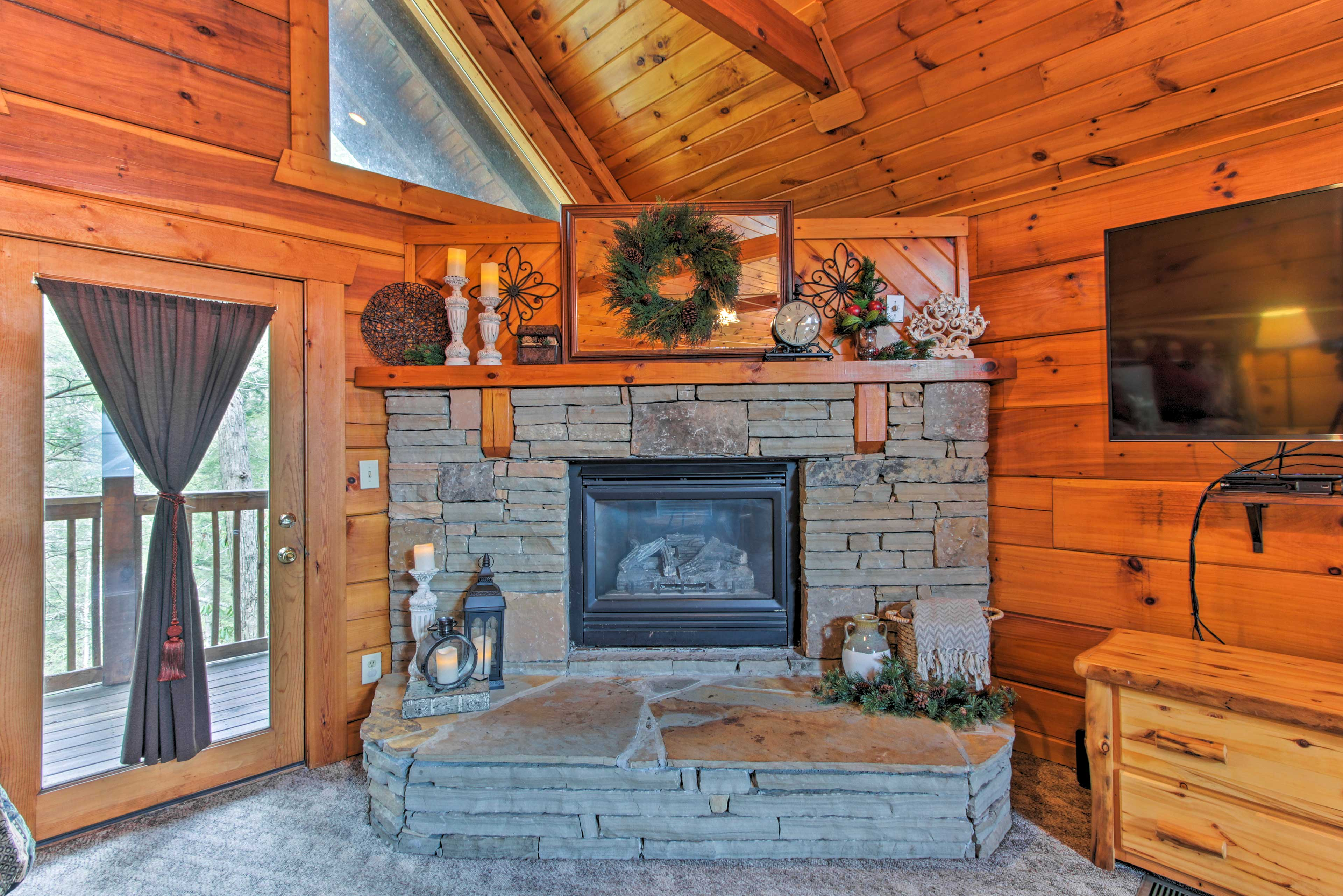A stacked stone gas fireplace is ready to warm you up on cool evenings.