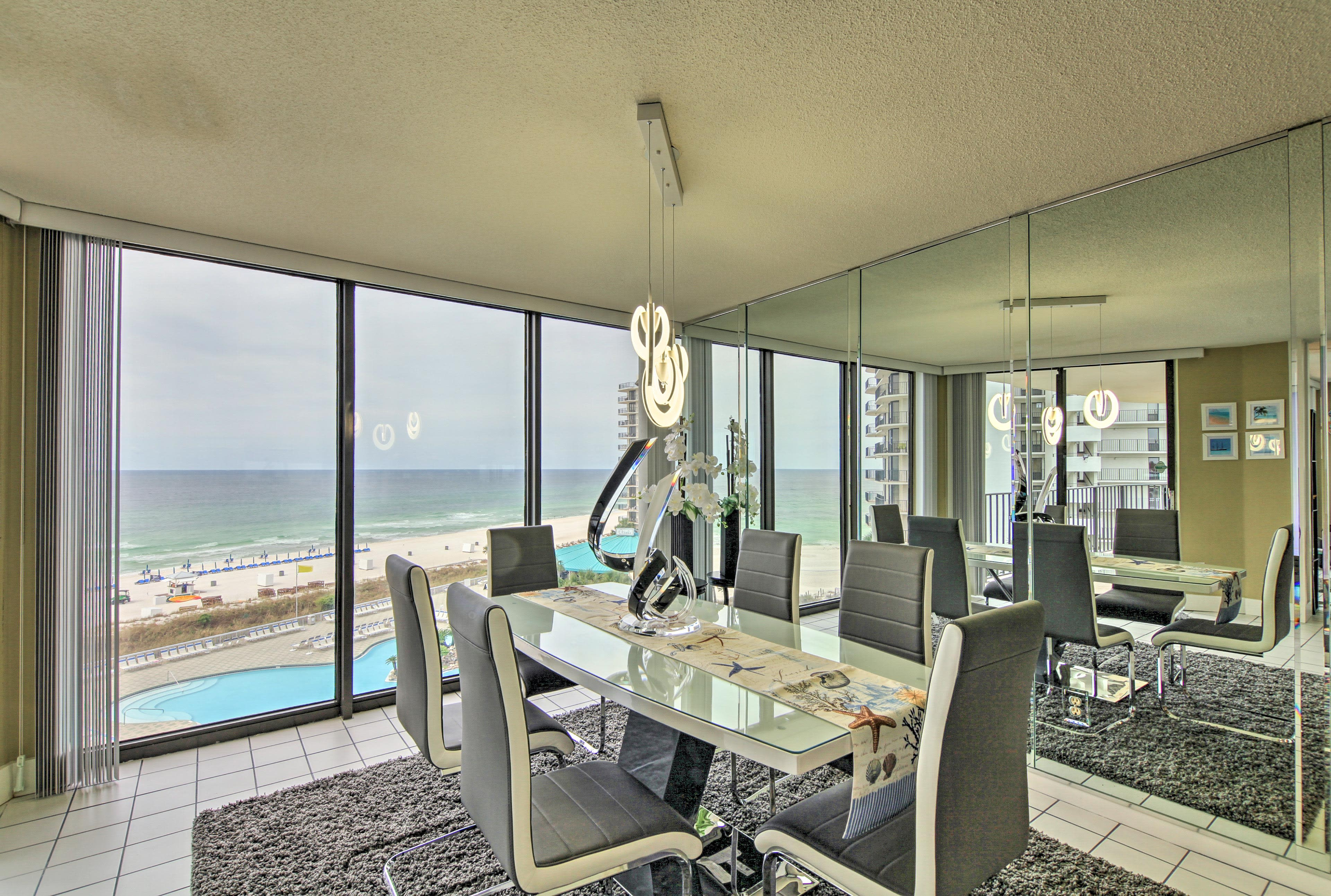 The dining nook is also lined with floor-to-ceiling windows.