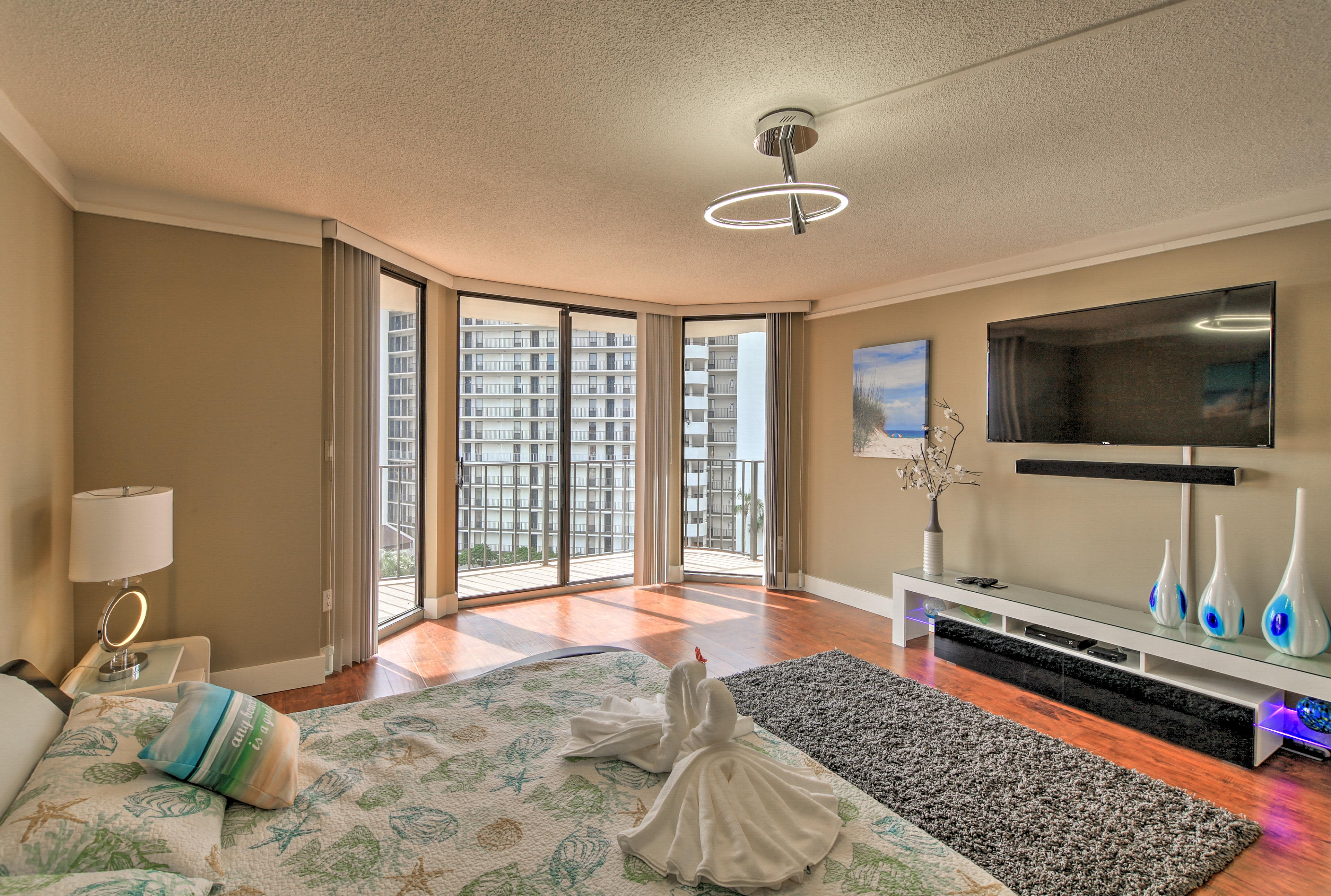 The master bedroom features a king bed and sliding doors to access the balcony.