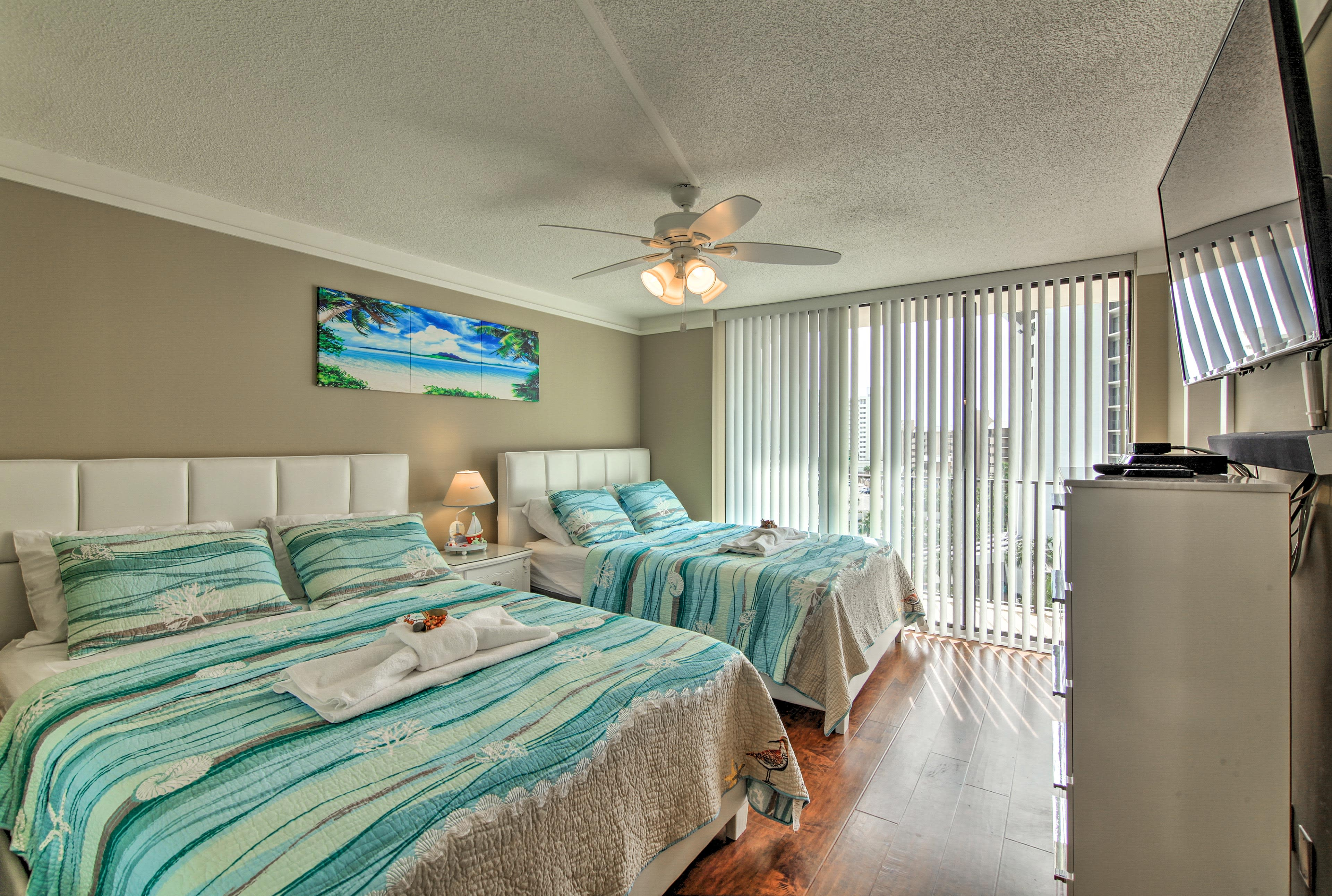 This second bedroom houses 2 queen-sized beds.