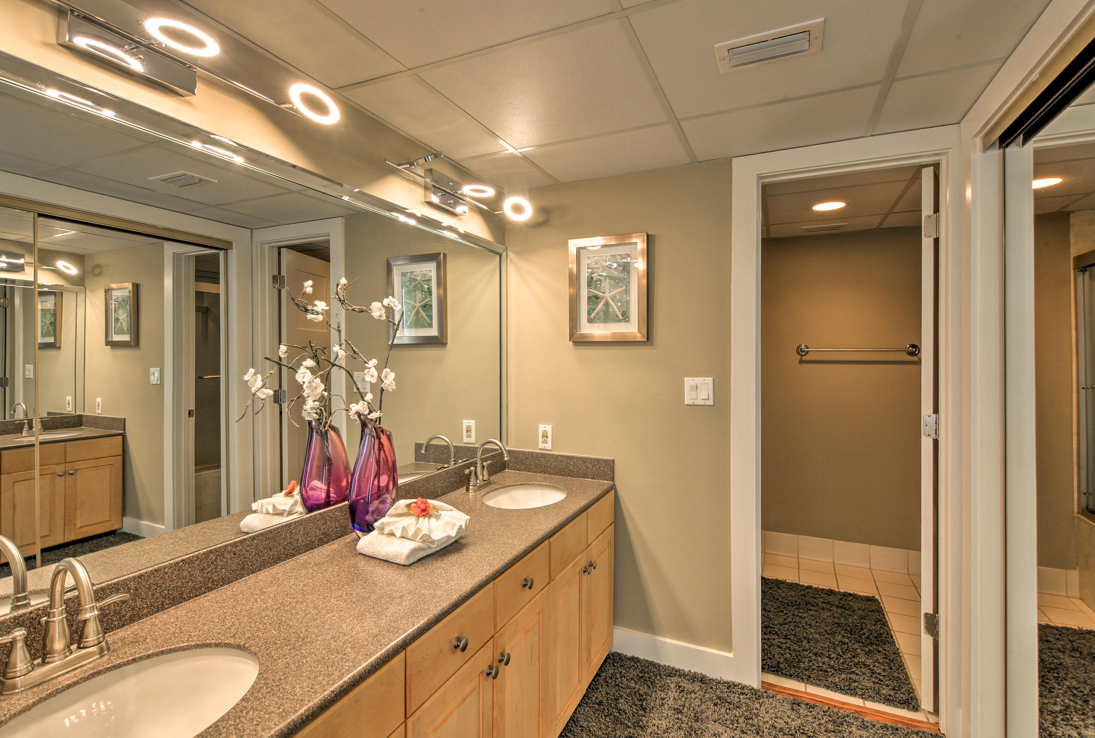 His-and-hers sinks and ample counter space make it easy to share this bathroom.