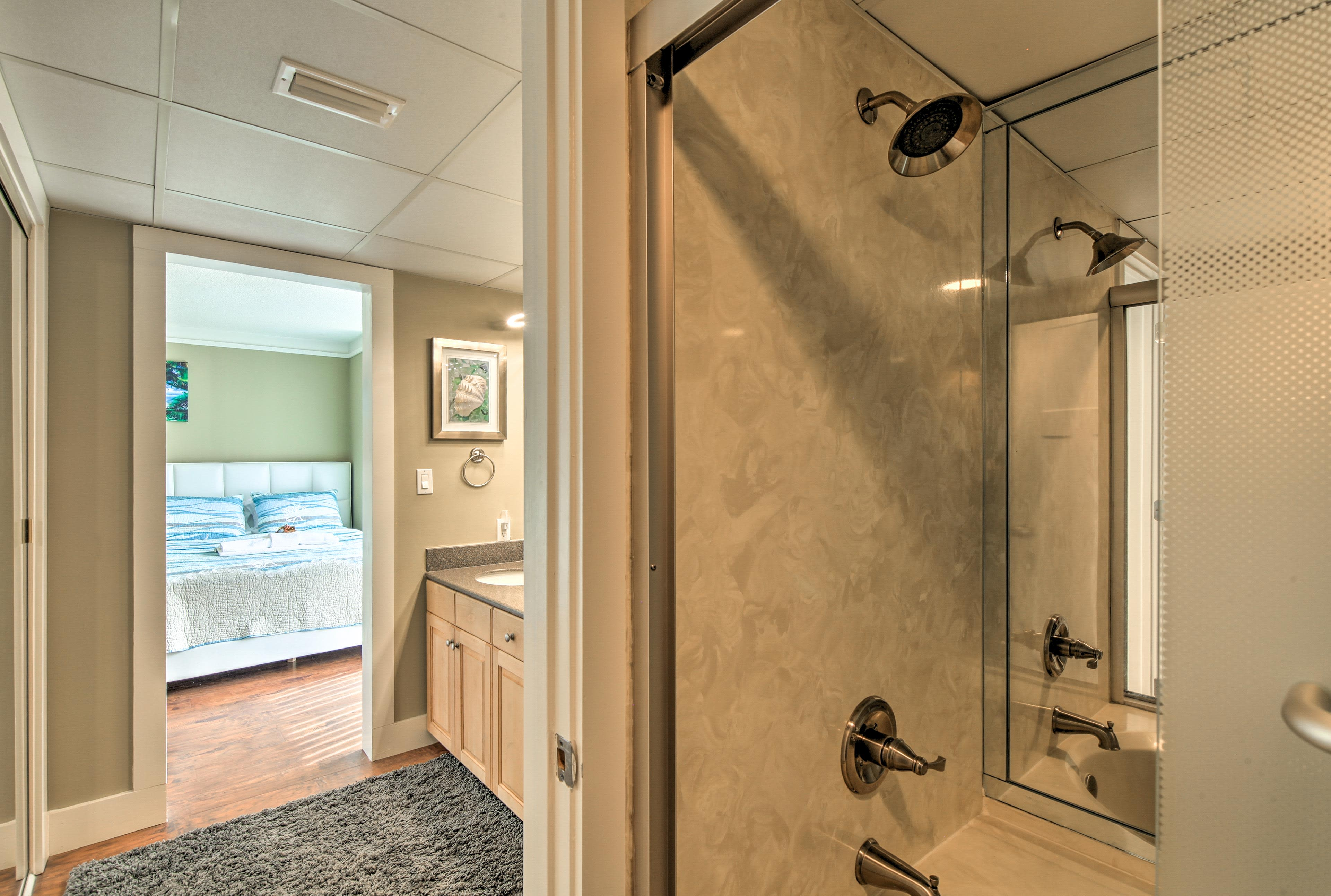 Rinse off the sunscreen in this pristine walk-in shower.