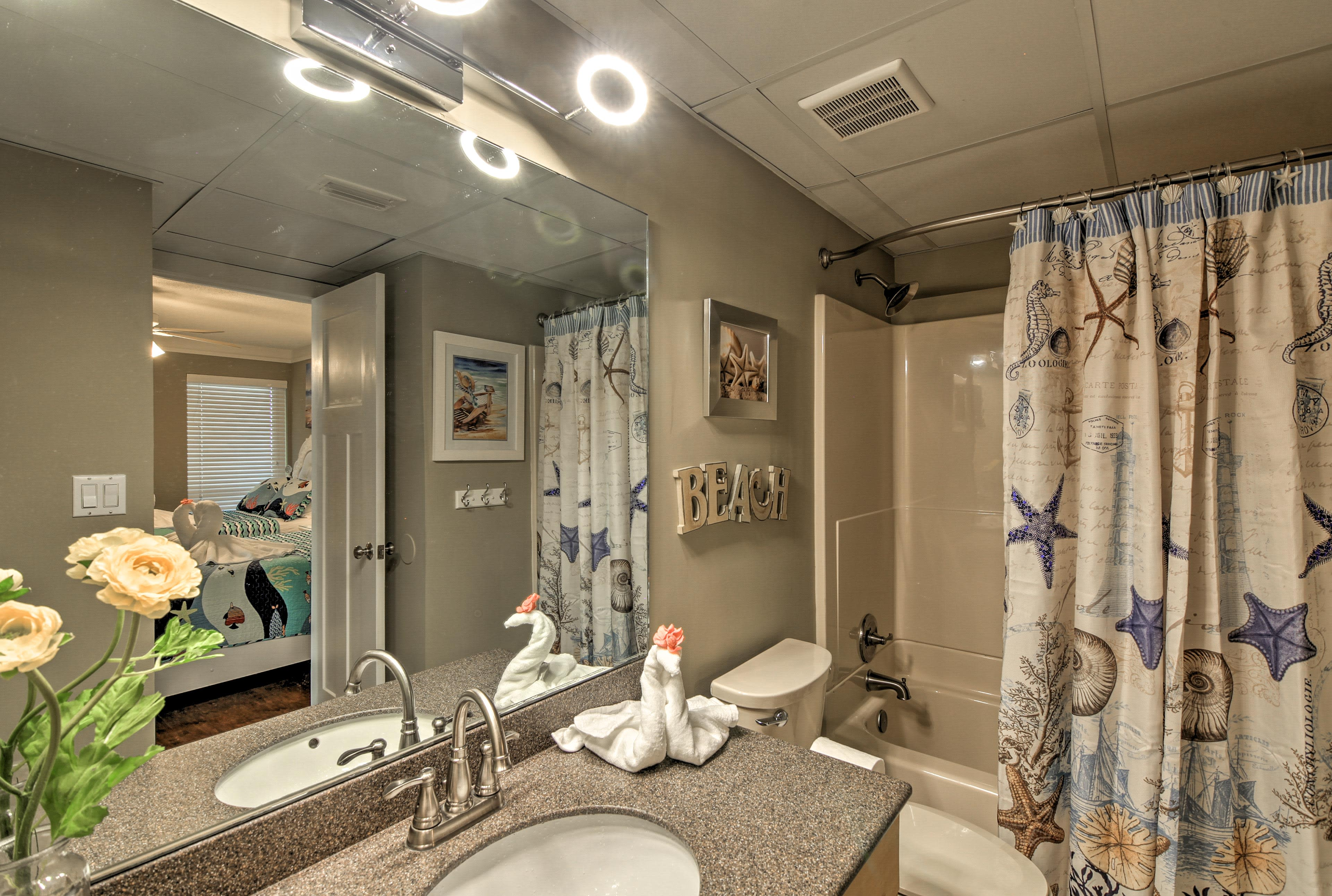 This bathroom is highlighted by a tub/shower combo.
