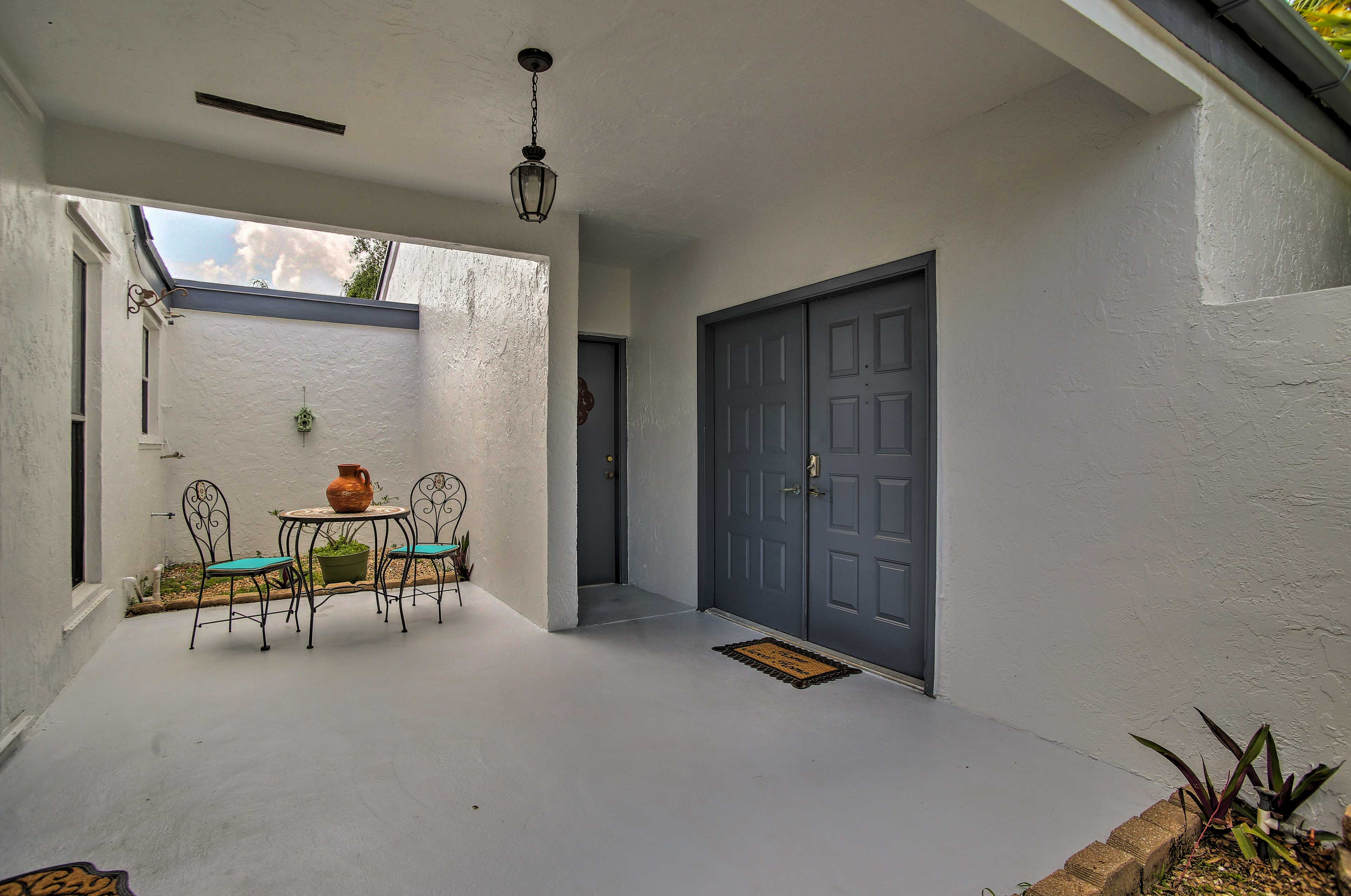 The covered patio is a great place to enjoy some fresh air.