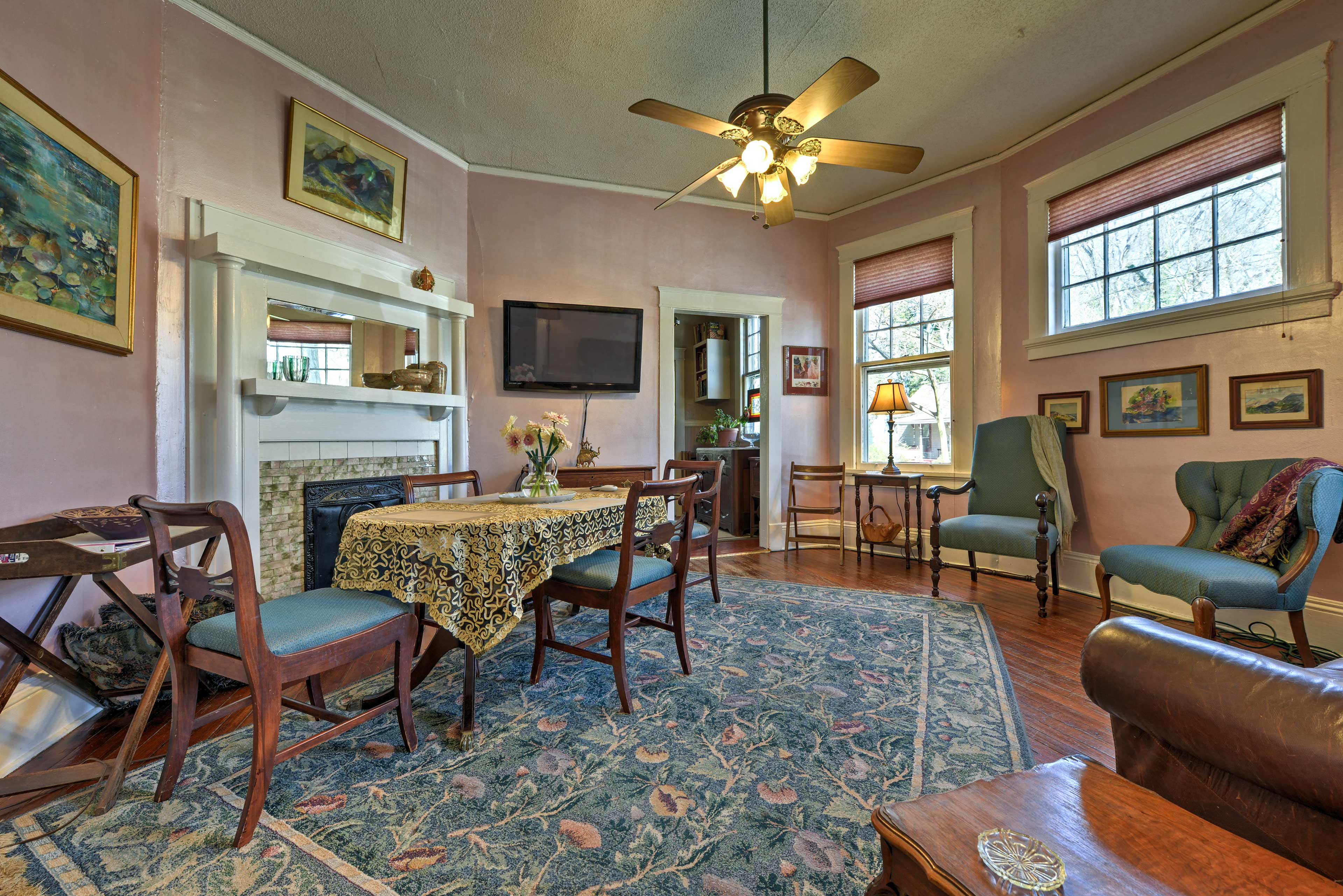 The spacious dining area includes a sofa and flat-screen cable TV.