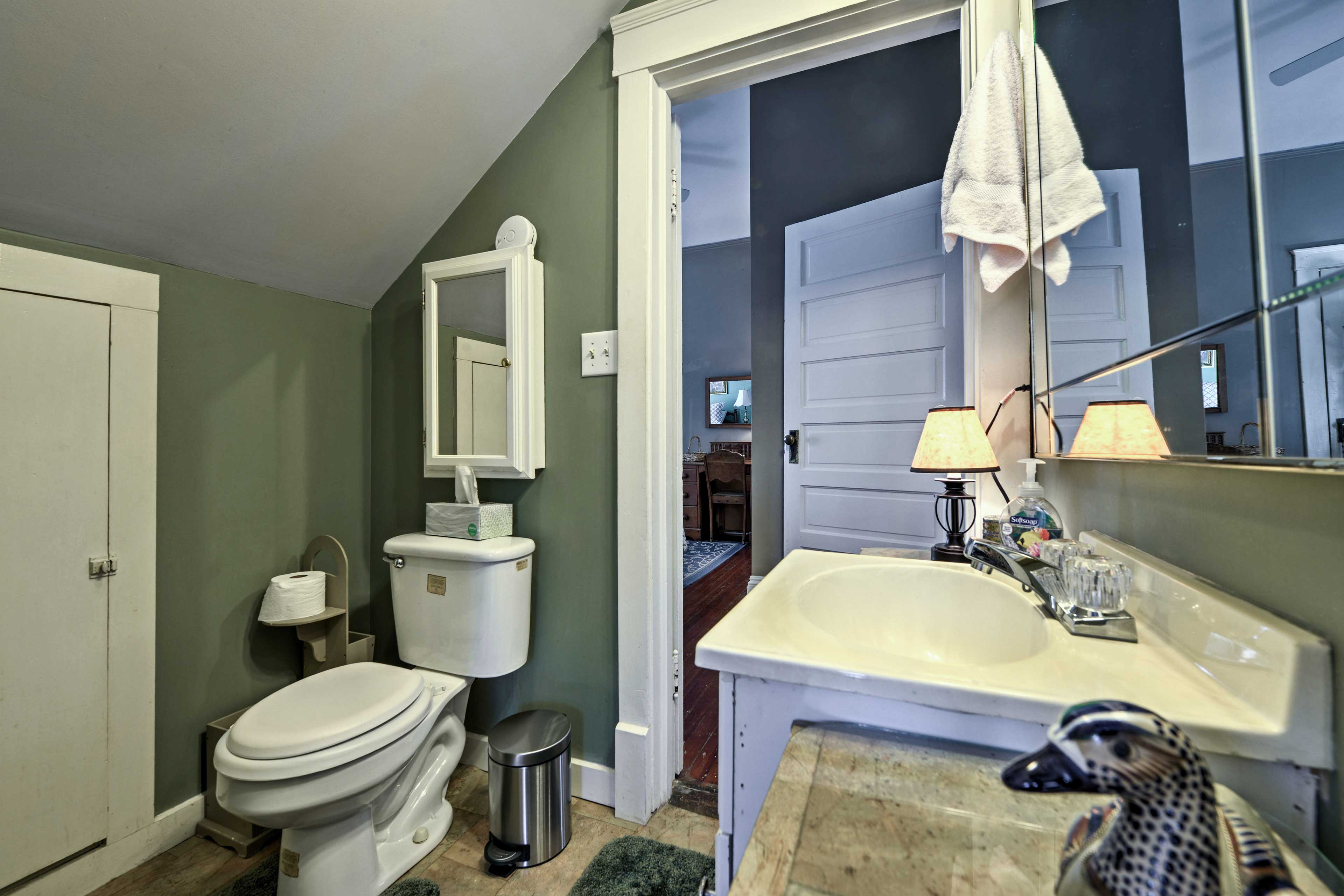 The half bathroom is conveniently connected to the second bedroom.