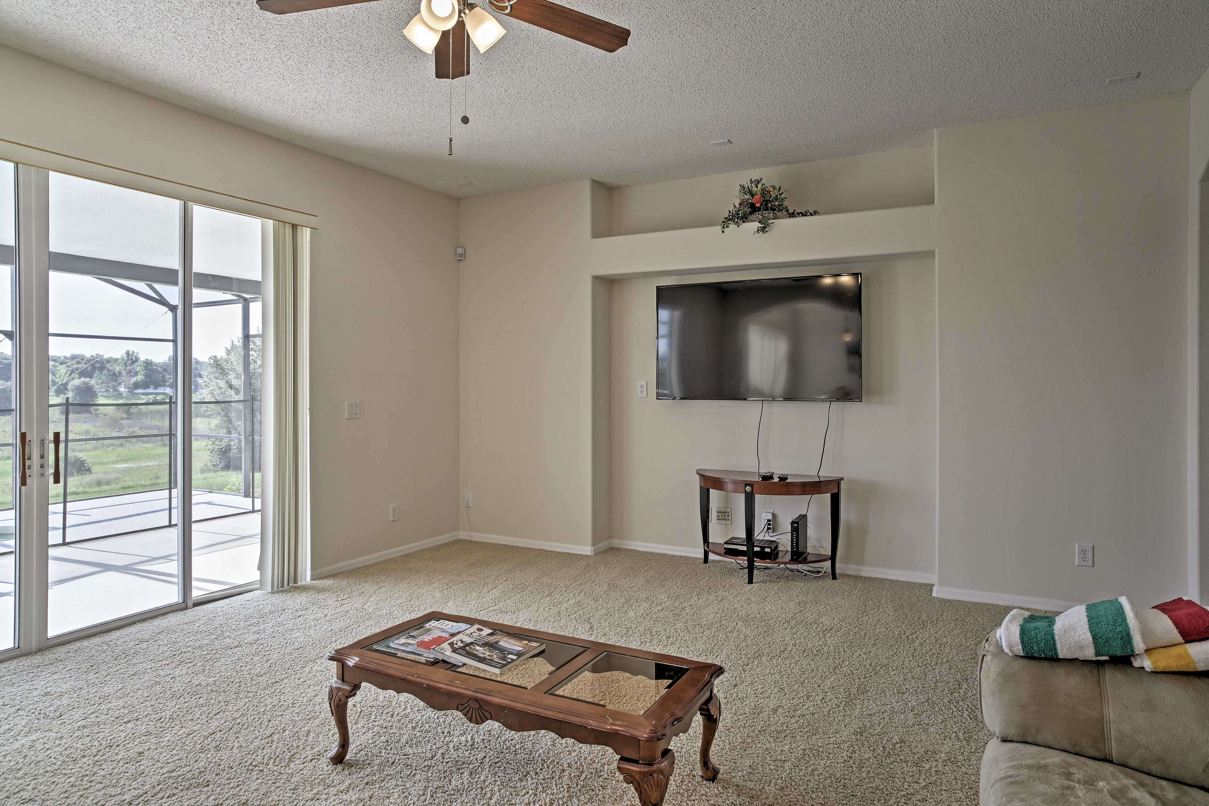 The living room offers 2 couches and a cable TV.
