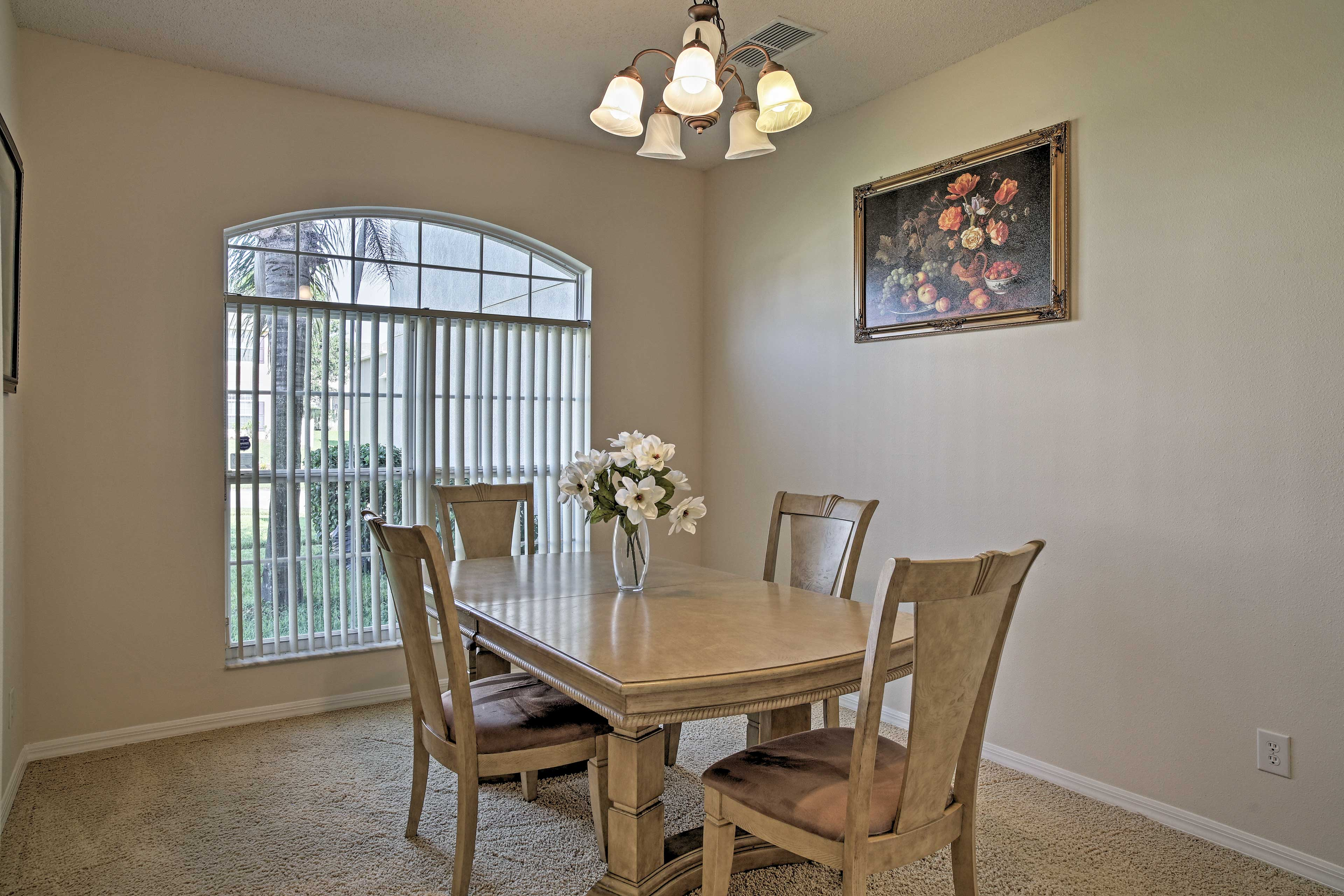 A formal dining table can be set to seat 4.