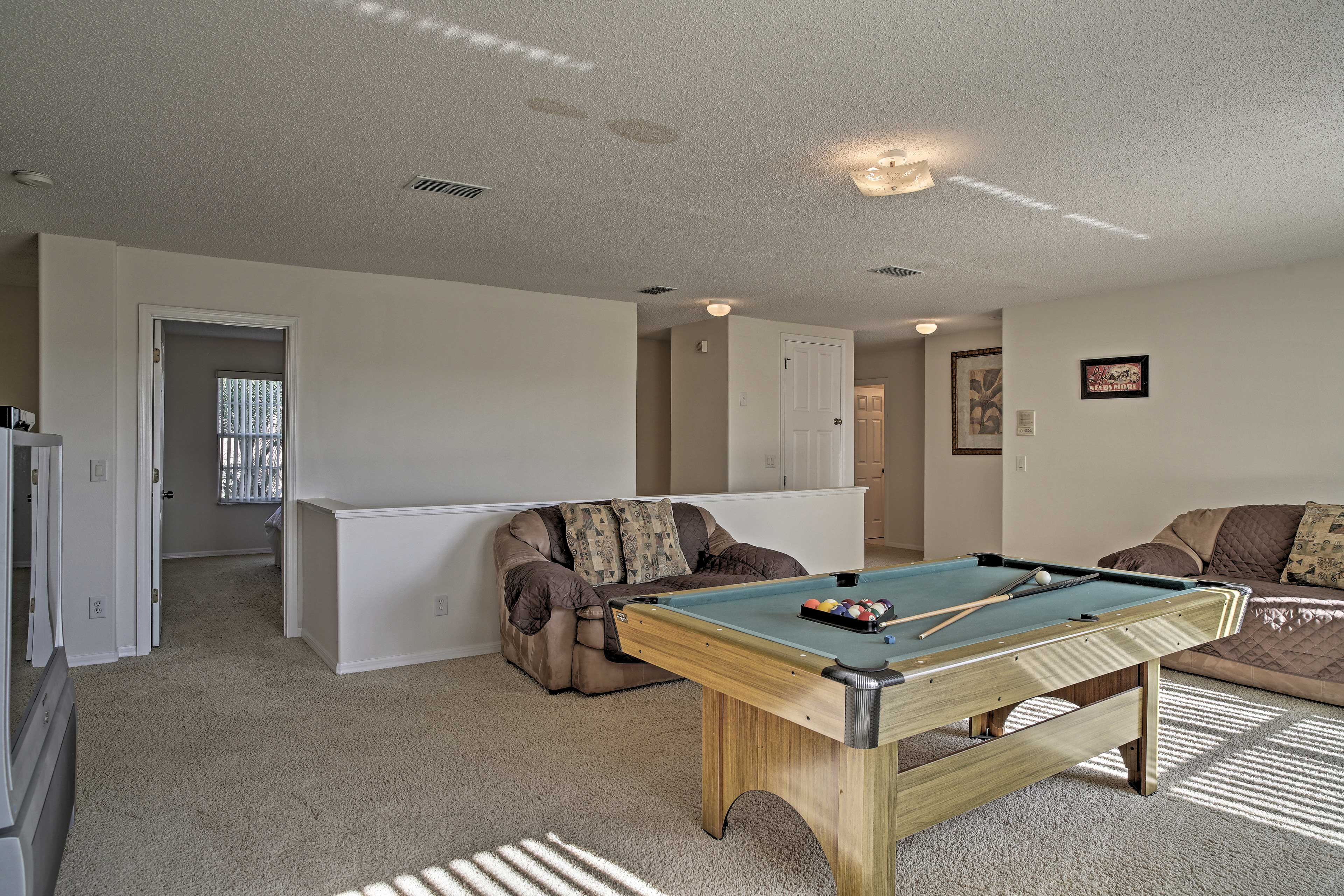 The second living room features a pool table!